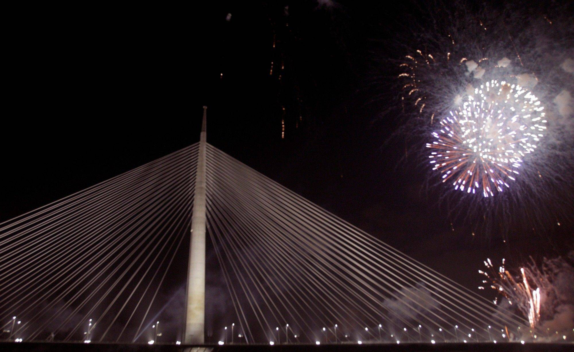 Fireworks illuminate the sky over newly-built cable-stayed Ada Bridge over the Sava river in Belgrade, Serbia, early Sunday, Jan. 1, 2012. The new Ada Bridge opened with fireworks at midnight on New Year's Eve. The new bridge is 964 meters (0.6 miles) long, 200 (219 yards) meters tall and 45 meters (49 yards) wide.