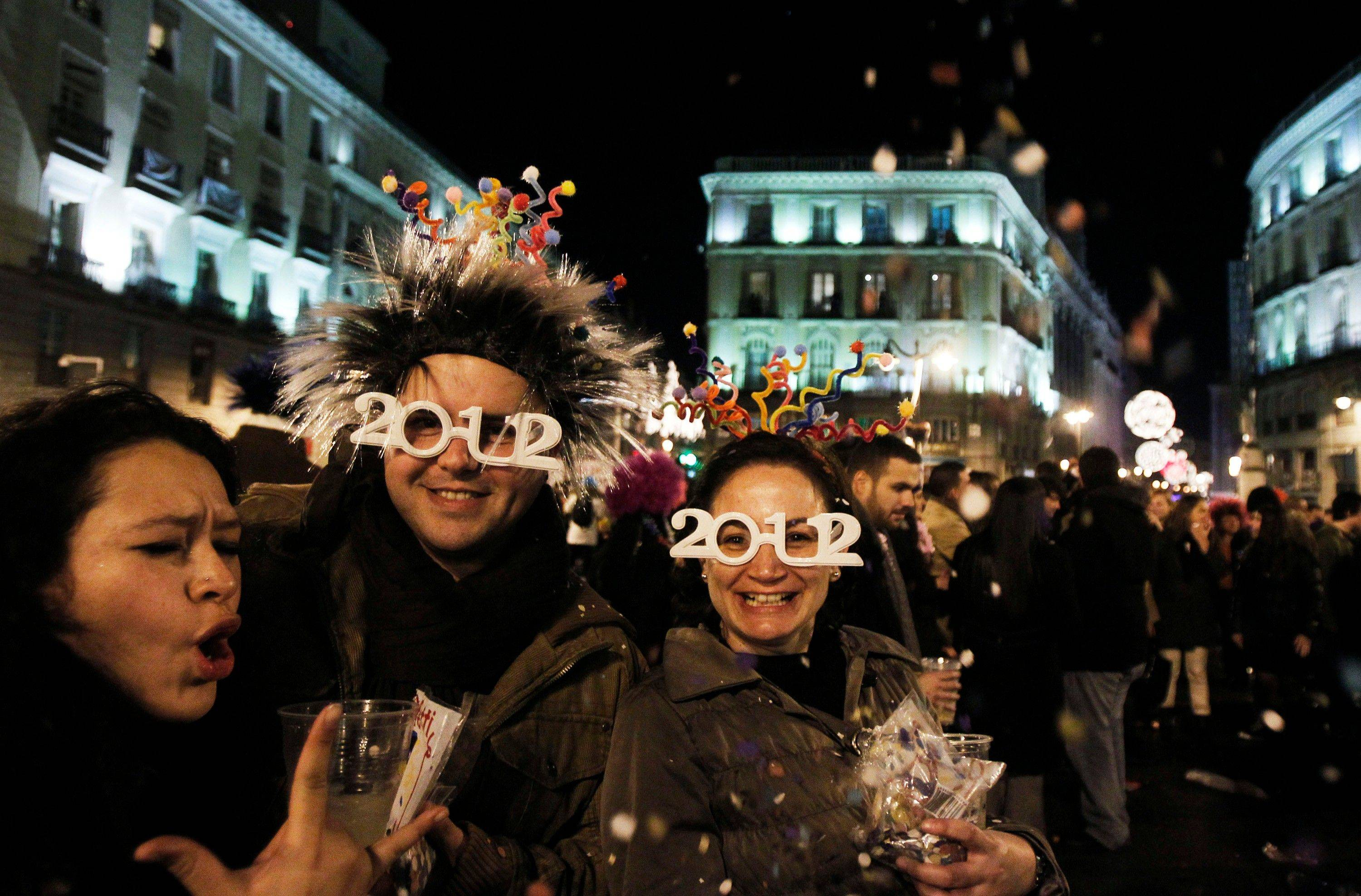 People gather for New Year's celebrations in Madrid, Spain, Sunday, Jan. 1, 2012.