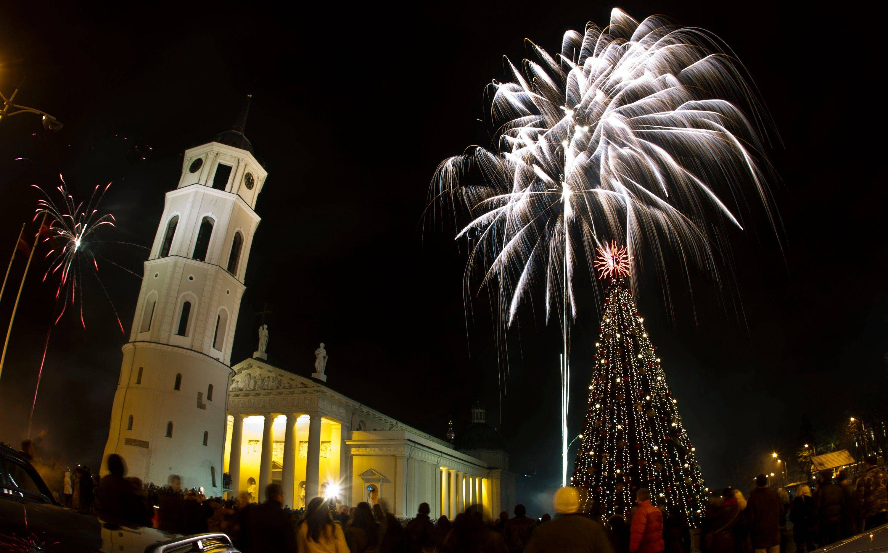Fireworks light the sky above the Cathedral Square in Vilnius shortly after midnight, greeting the New Year, Sunday, Jan. 1, 2012. Thousands of people celebrated the beginning of the New Year 2009 in the Lithuanian capital.