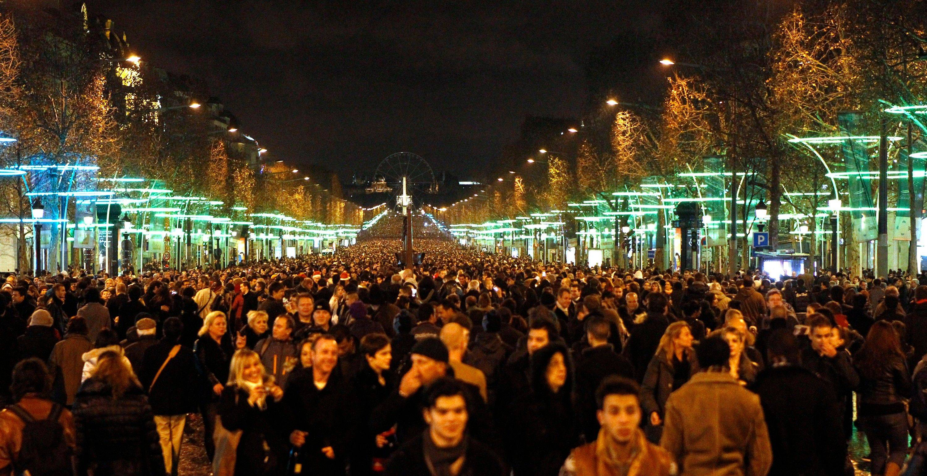 Revelers celebrate the New Year on the Champs Elysees avenue in Paris, Sunday Jan. 1, 2012.