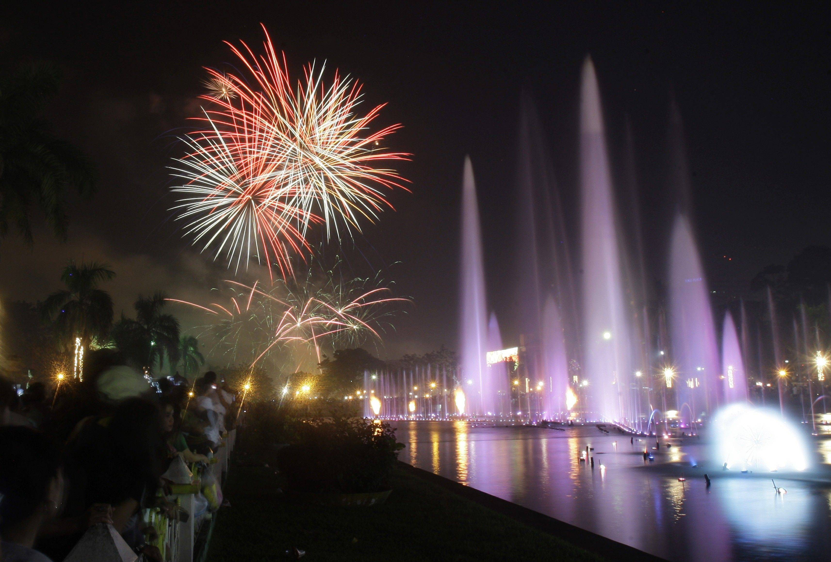 Filipinos watch a fireworks and water fountain display as they welcome the New Year at Manila's Rizal Park, Philippines on Sunday Jan. 1, 2012. More than 200 people have been injured by illegal firecrackers and celebratory gunfire in the Philippines despite a government scare campaign against reckless New Year revelries, officials recently said.