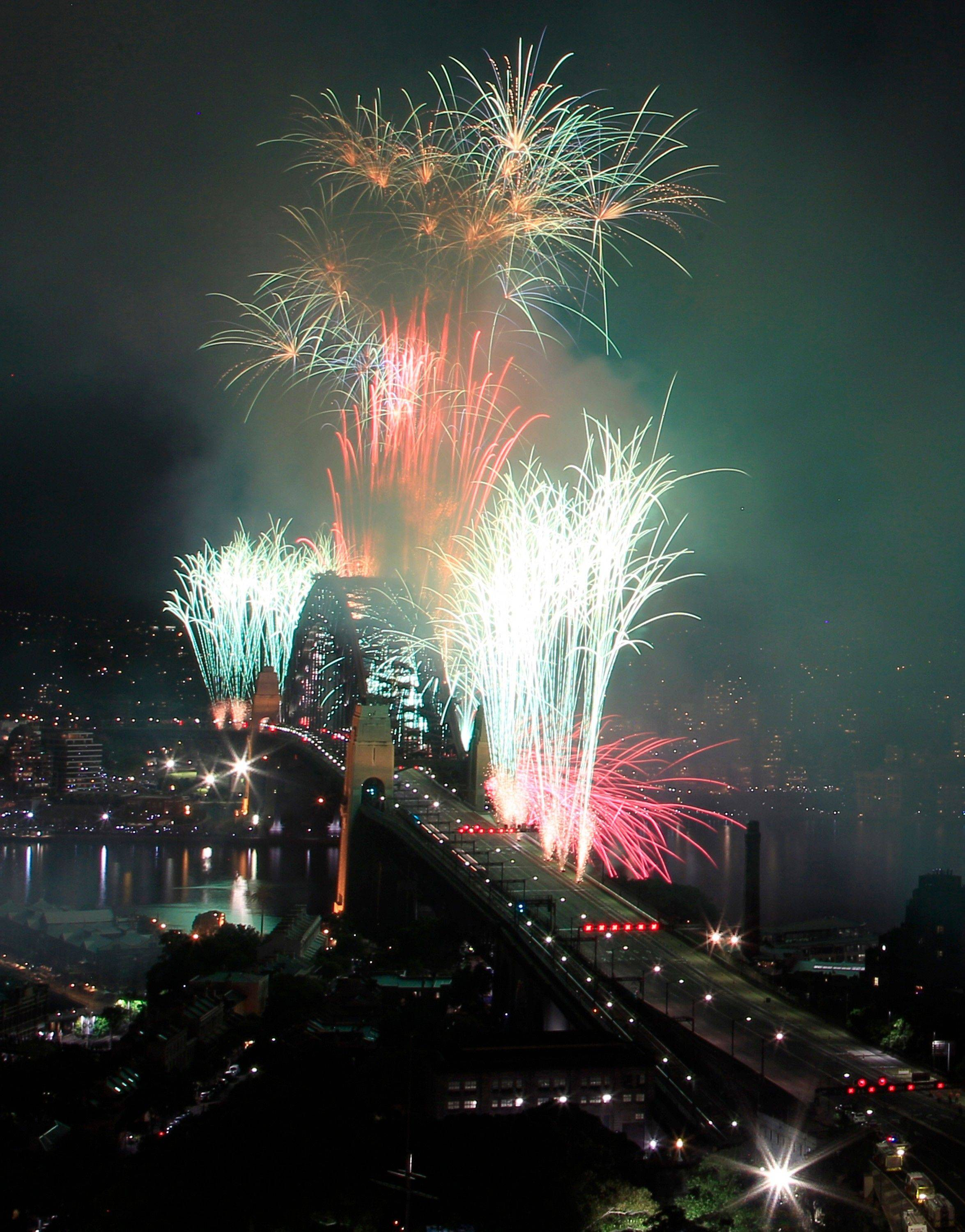 Fireworks burst over the Sydney Harbour Bridge during New Year's celebrations in Sydney, Sunday, Jan. 1, 2012.