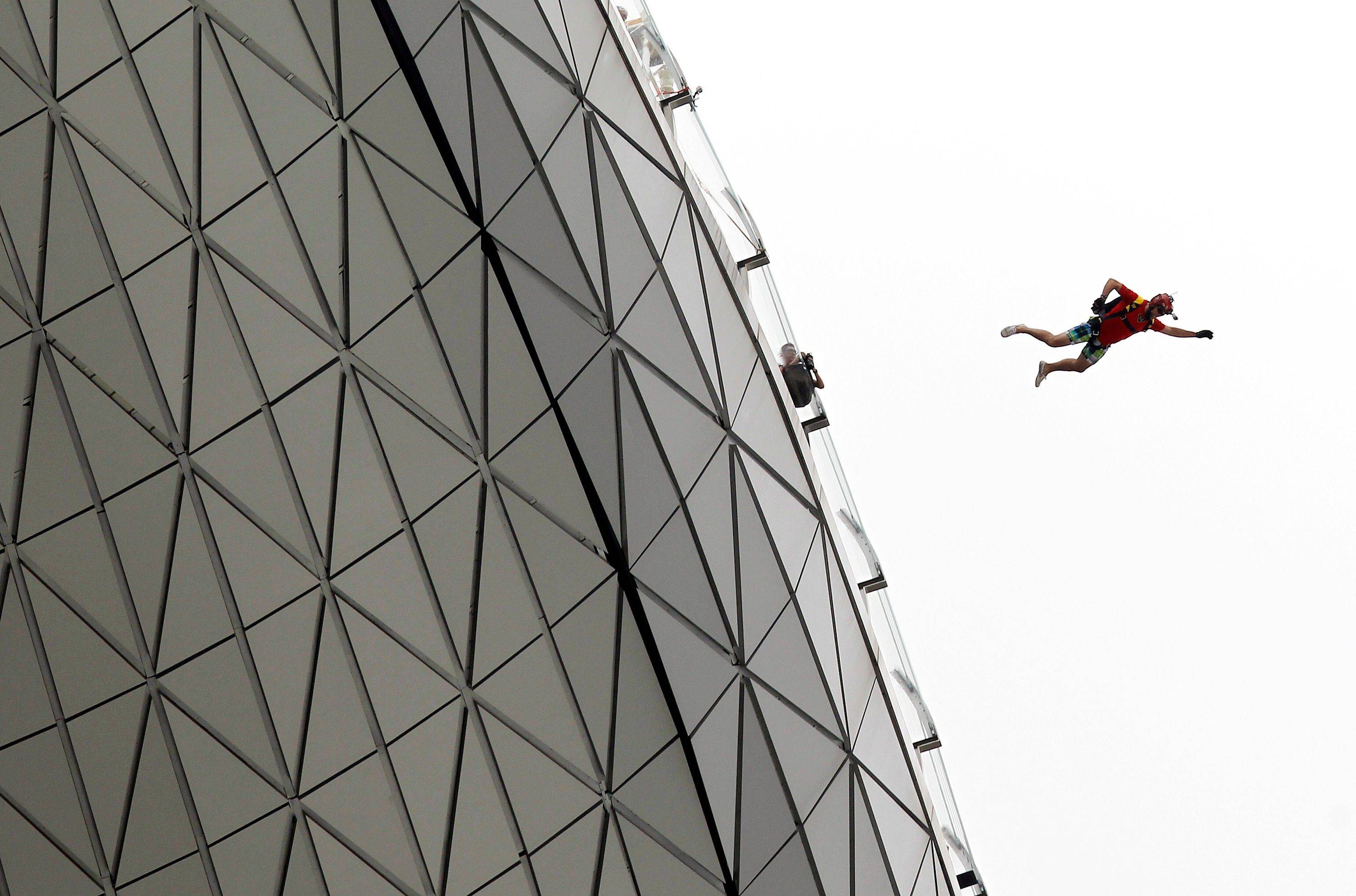 "One of six professional base jumpers from around the world leapt off the Observation Deck of the Marina Bay Sands ""SkyPark"" to mark the start of the new year in Singapore, Sunday Jan. 1, 2012."