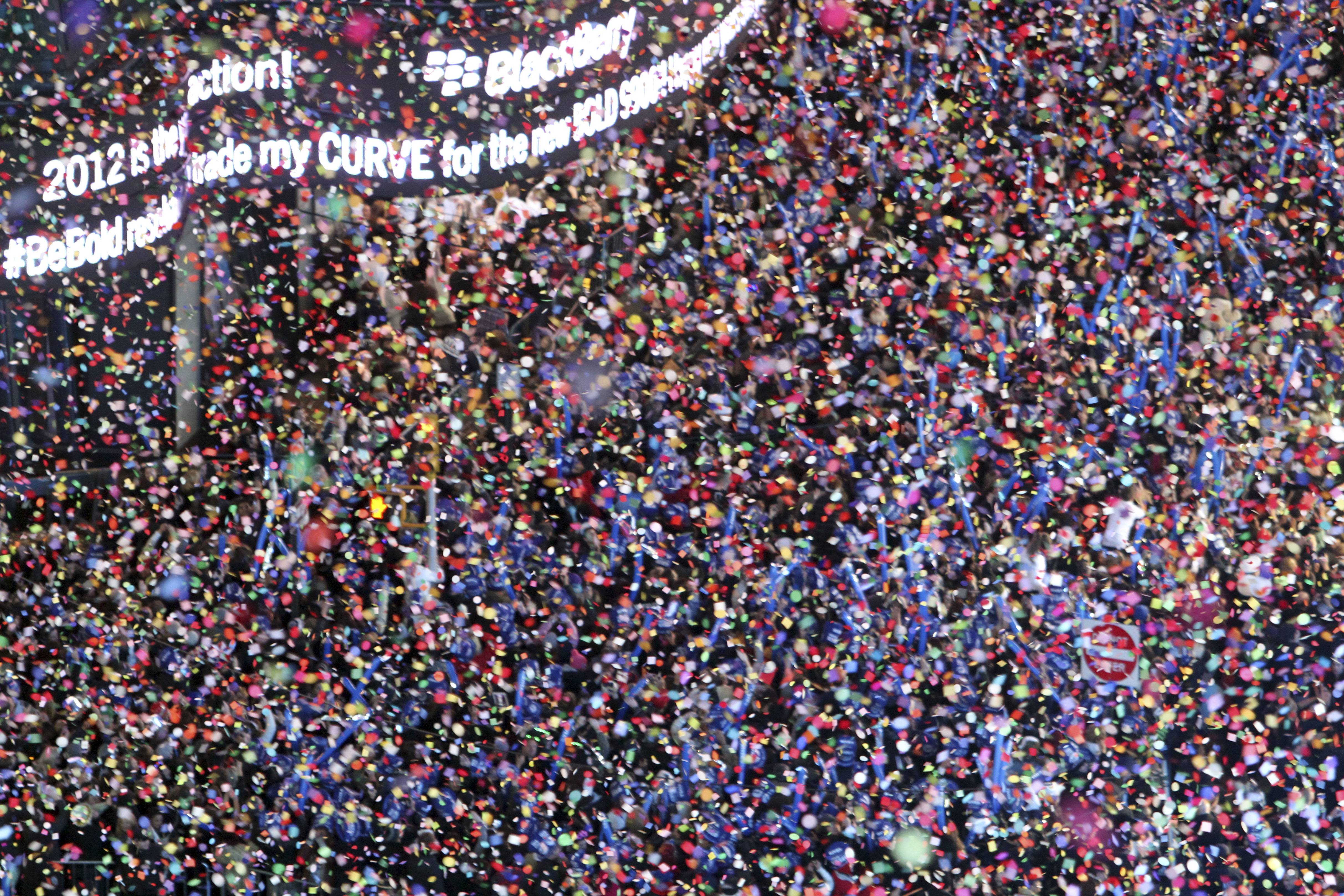 Confetti flies over New York's Times Square as the clock strikes midnight during the New Year's Eve celebration as seen from the balcony of the Marriott Marquis hotel.