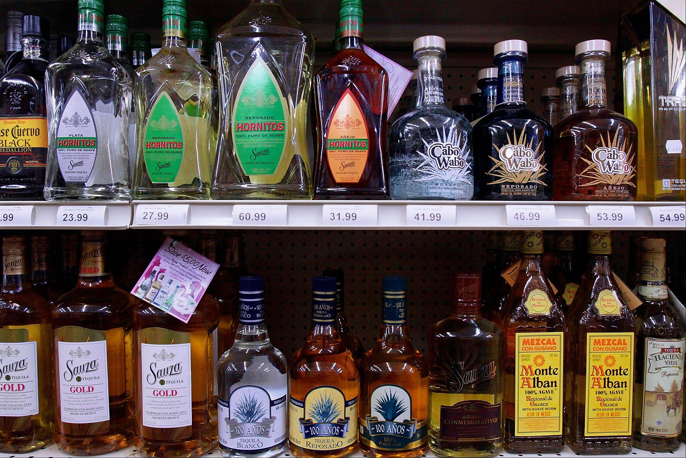 In August 2009, bottles of alcohol are seen lining the shelves of a liquor store in Springfield. It's the time of year that social host liability laws can leave parents vulnerable for teens drinking under their roofs.