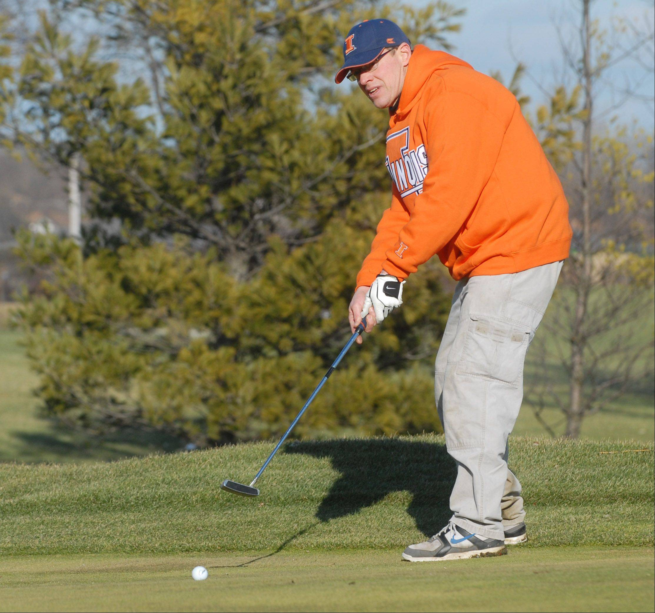 Phil Priest of Rolling Meadows completes a round of golf at the Arlington Lakes Golf Club in Arlington Heights Thursday.