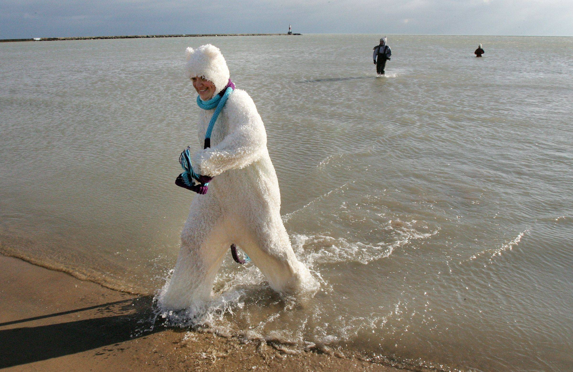 450 take the Polar Bear Plunge into Lake Michigan