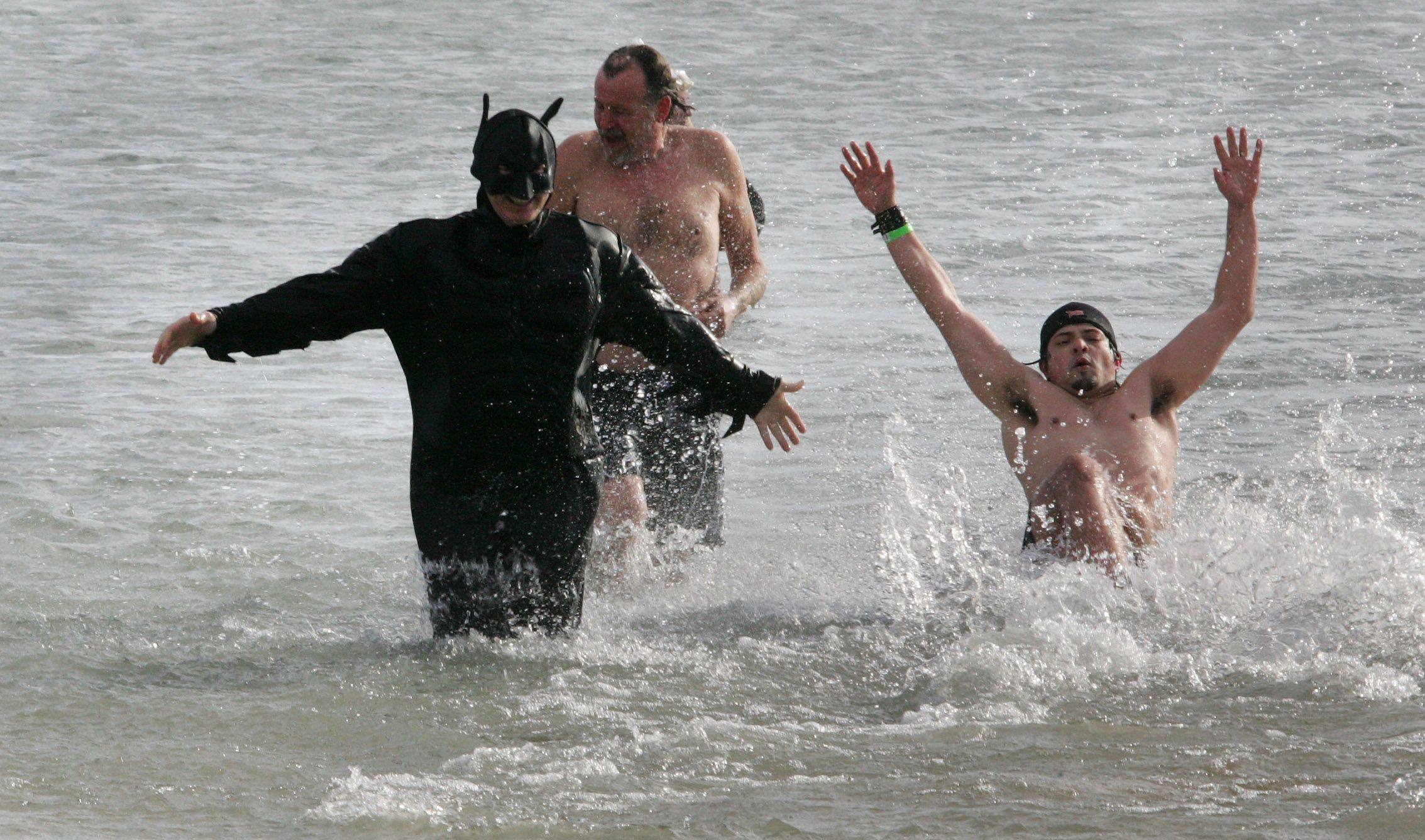 Greg Whipple of Lindenhurst dressed as Batman during the 13th Annual Polar Bear Plunge Sunday in Waukegan. The event benefits Special Recreation Services of Northern Lake County.