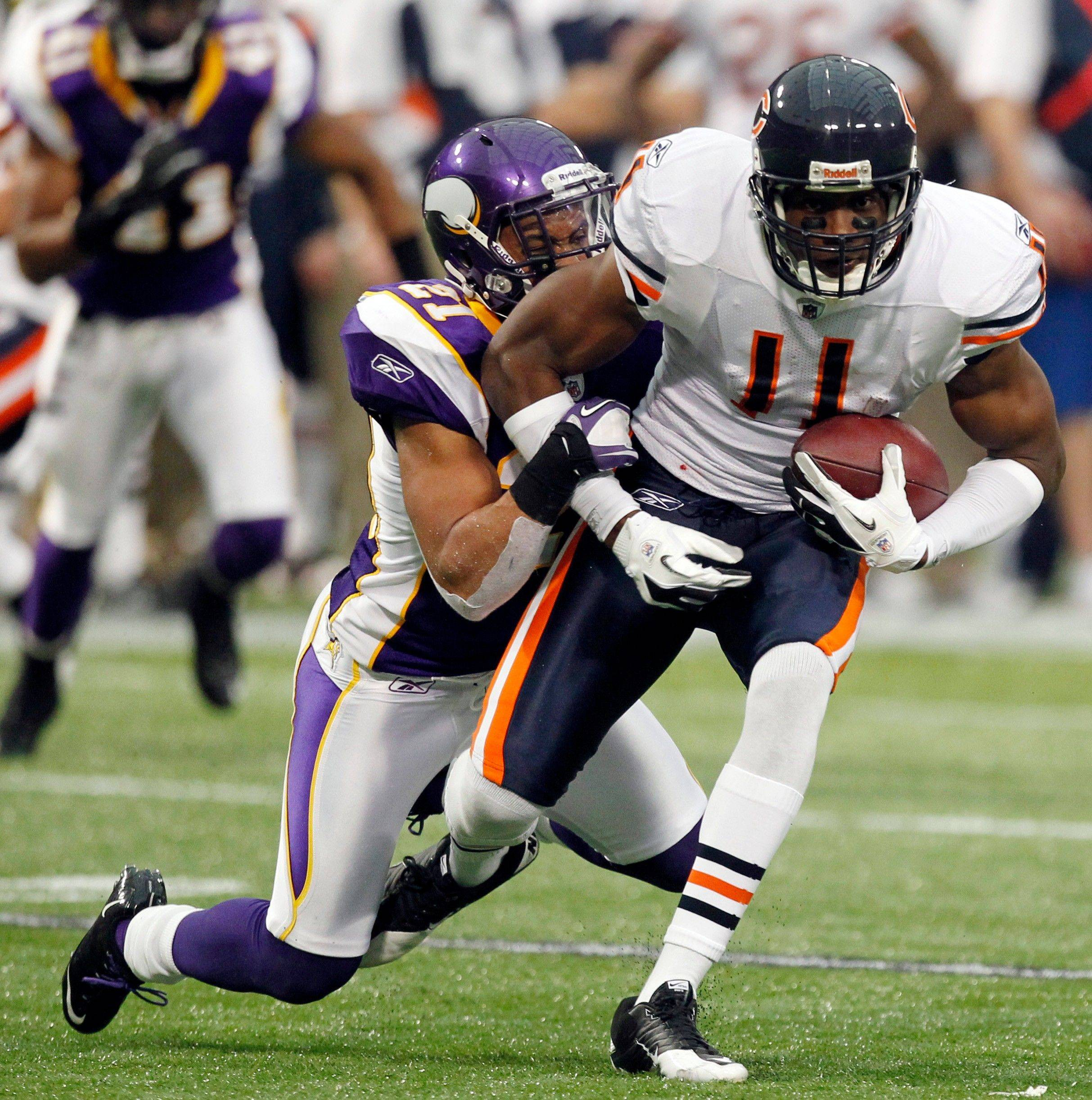 Chicago Bears wide receiver Roy Williams gets tackled by Minnesota Vikings cornerback Asher Allen after making a first down reception in the second half of an NFL football game in Minneapolis, Sunday, Jan. 1, 2012.