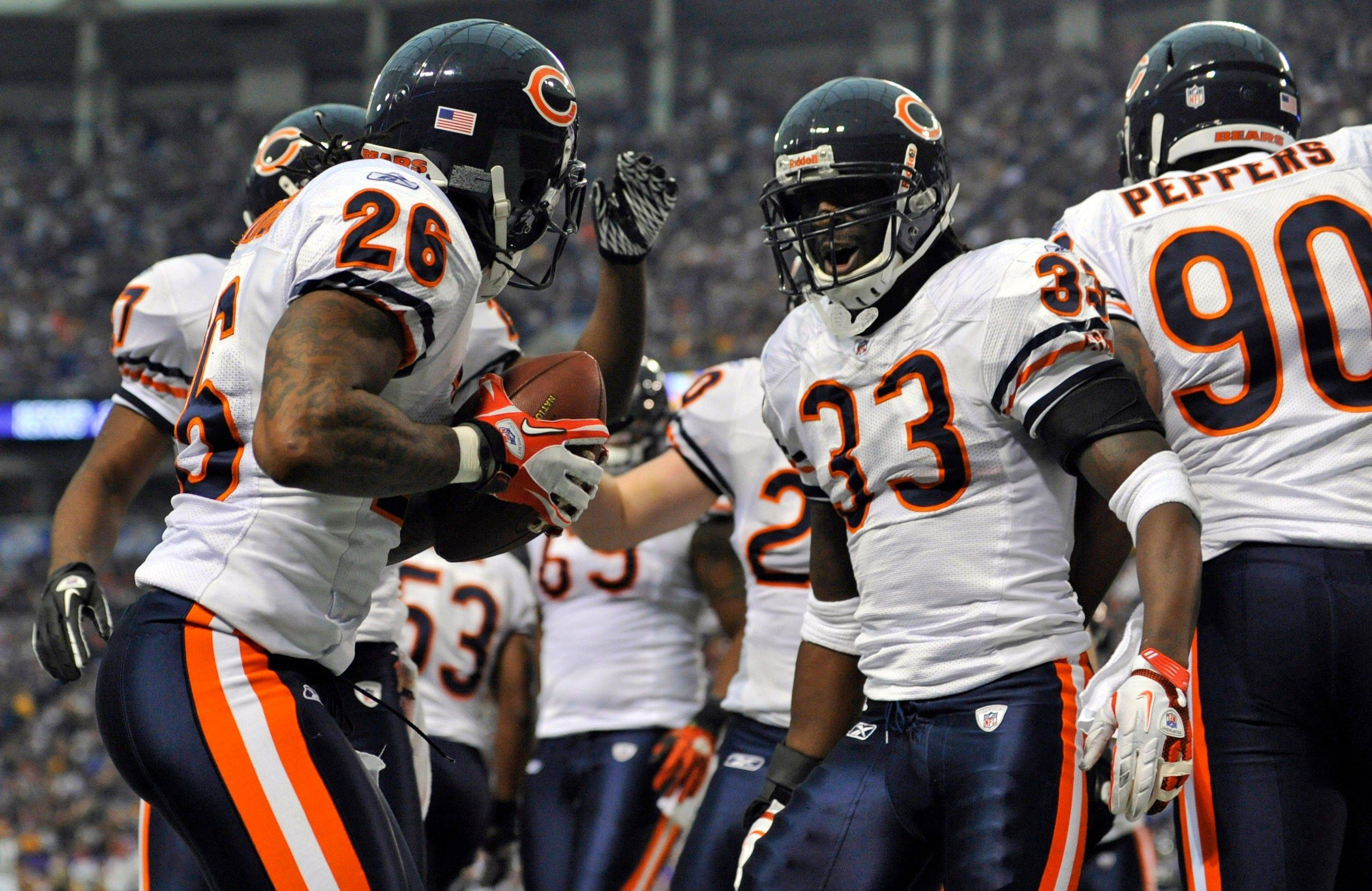 Chicago Bears cornerback Charles Tillman celebrates his 22-yard interception return with cornerback Tim Jennings in the first half.