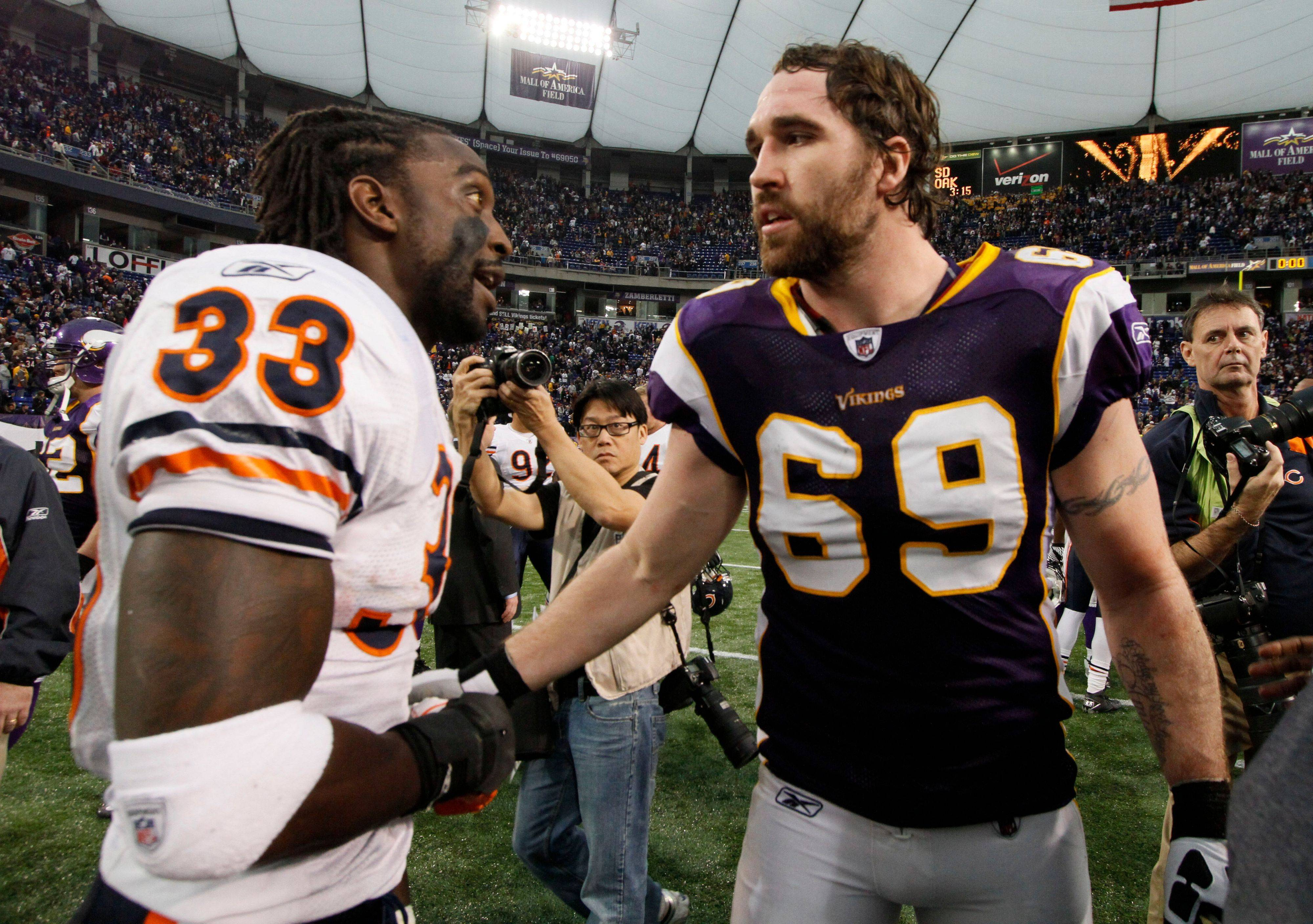 Chicago Bears cornerback Charles Tillman and Minnesota Vikings defensive end Jared Allen greet each other after their NFL football game. The Bears won 17-13.