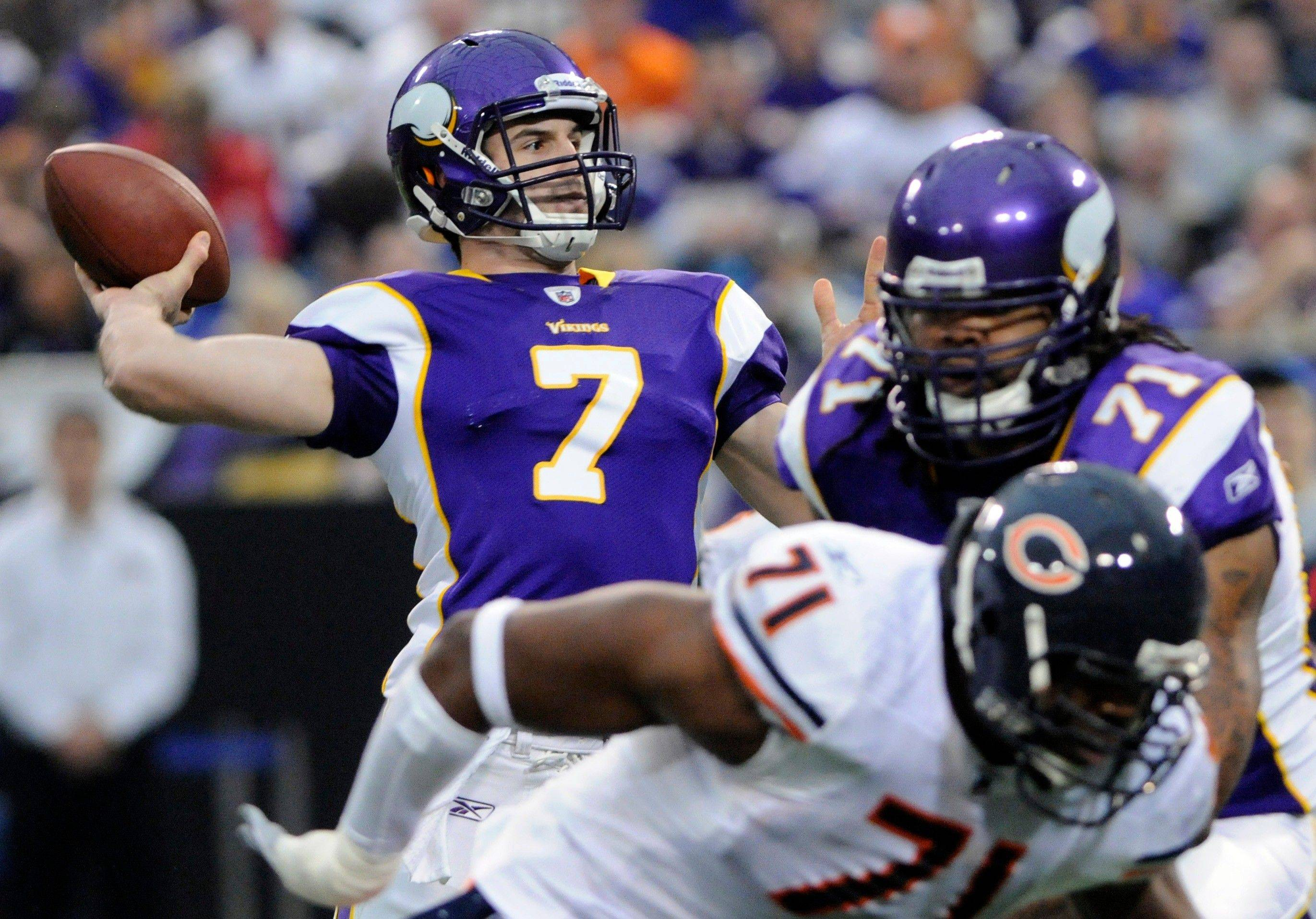 Minnesota Vikings quarterback Christian Ponder throws a pass in the first half.