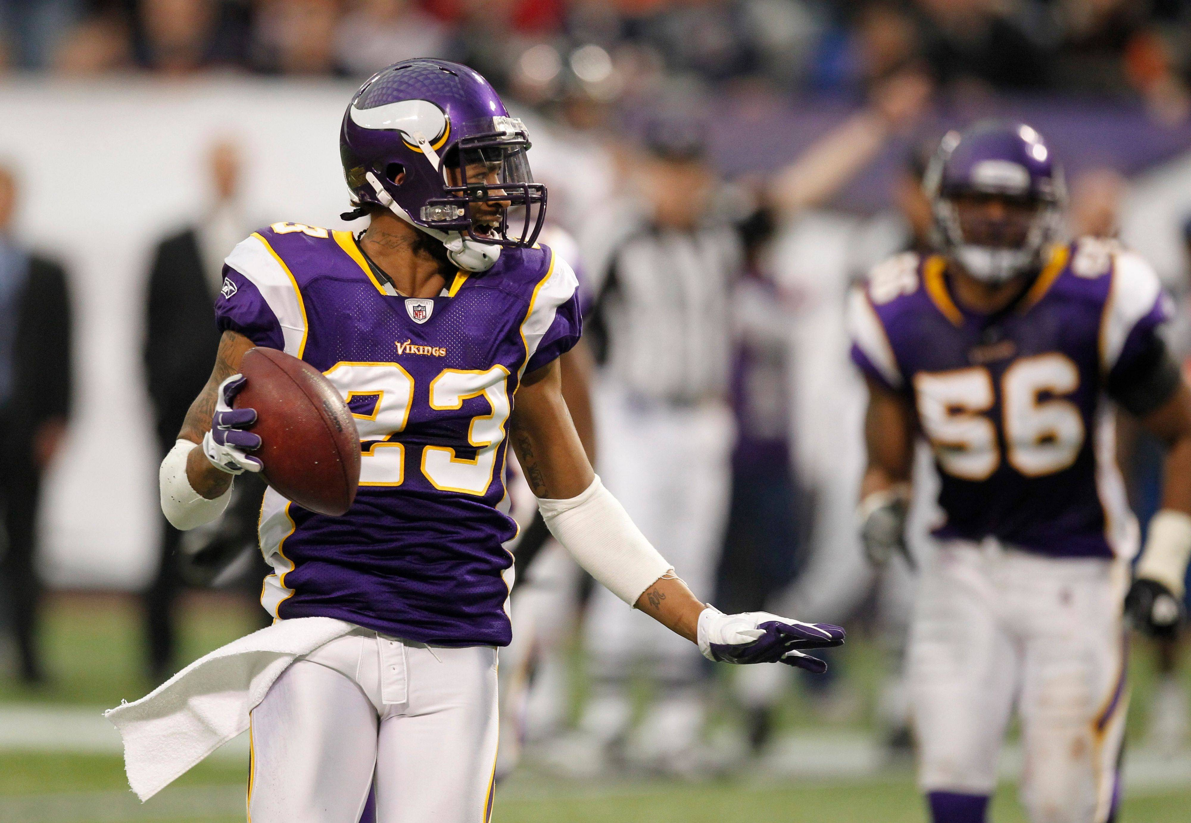 Minnesota Vikings cornerback Cedric Griffin celebrates after intercepting a pass in the second half.