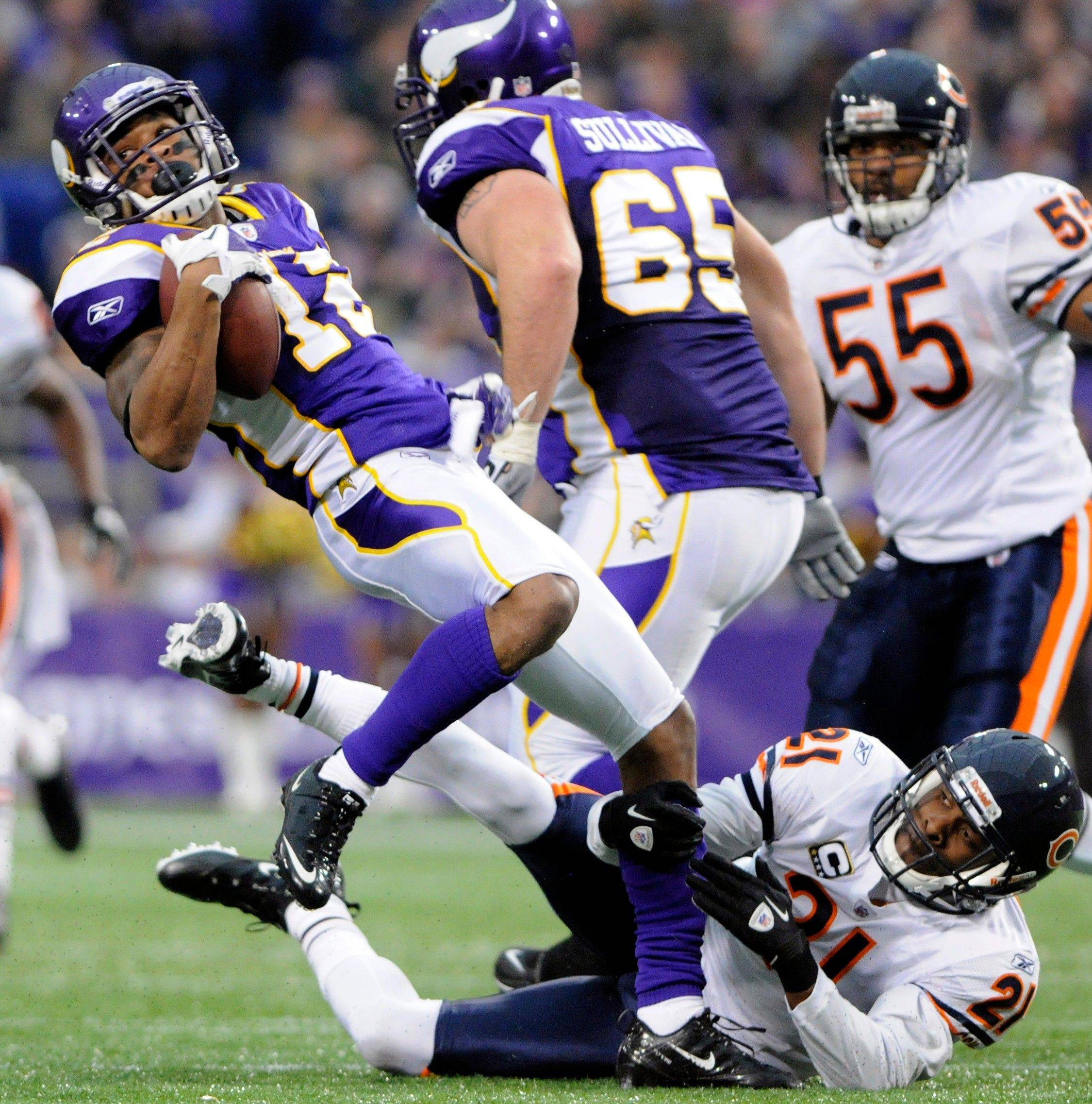 Minnesota Vikings wide receiver Percy Harvin gets tacked by Chicago Bears defensive back Corey Graham in the first half.