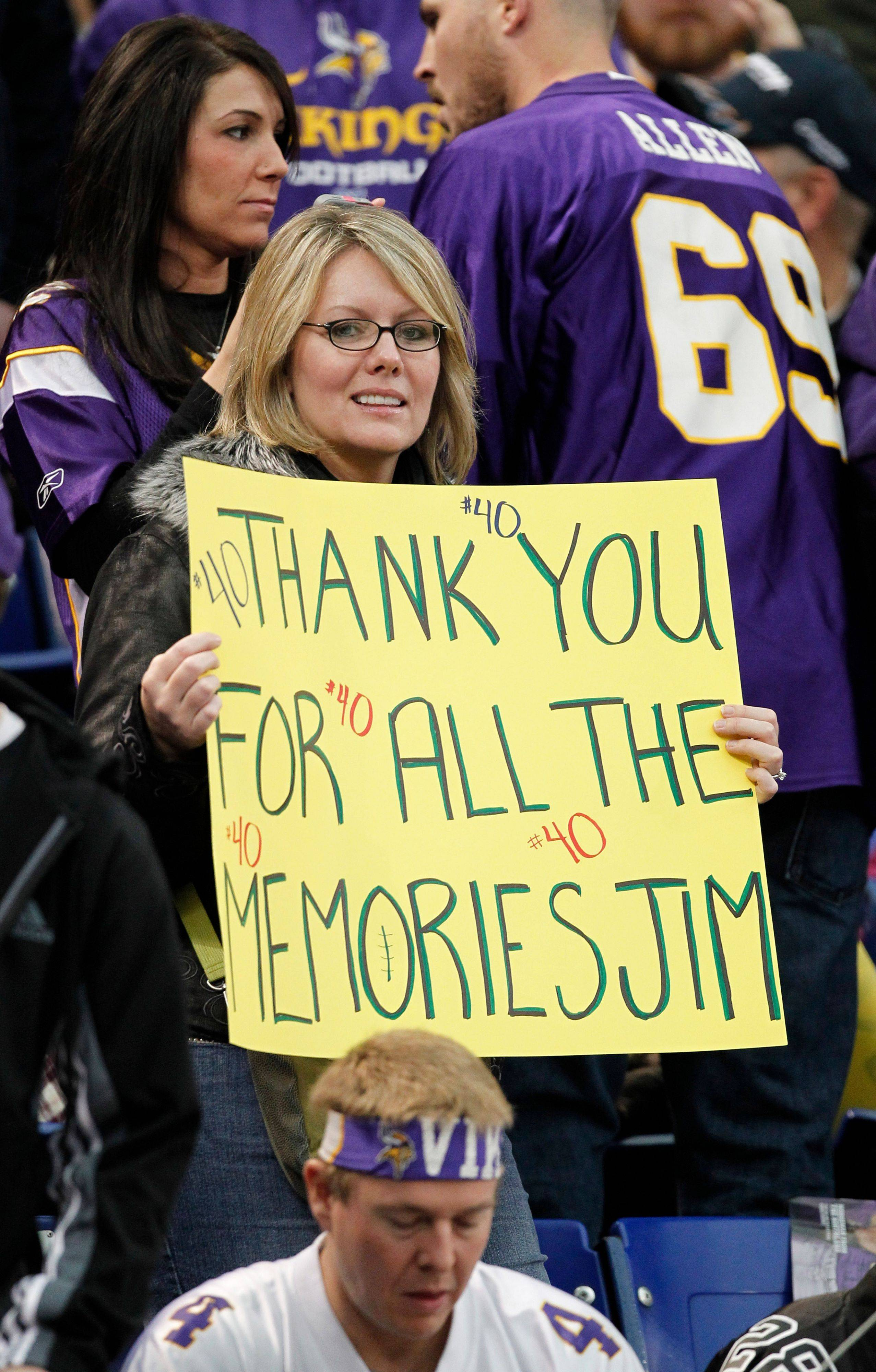 A Minnesota Vikings fan holds up a sign before an NFL football game against the Chicago Bears.