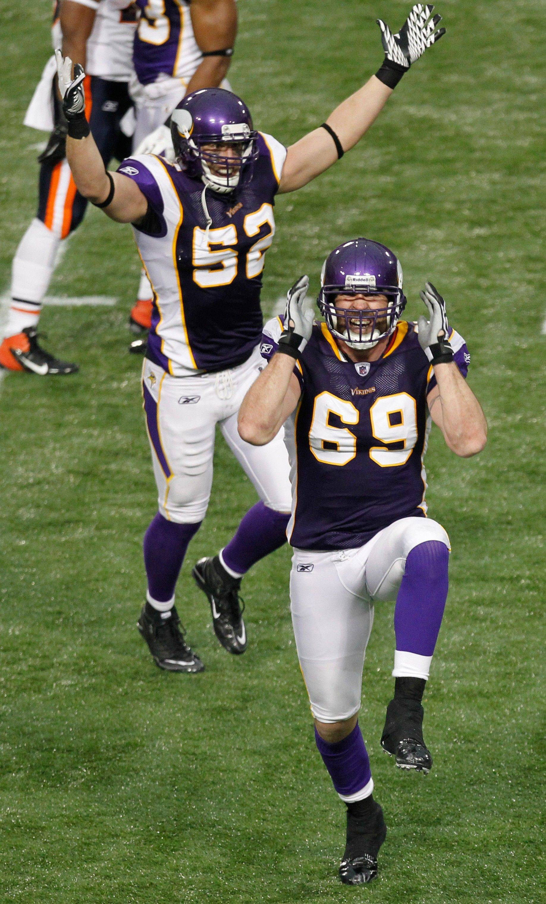Minnesota Vikings defensive end Jared Allen celebrates after sacking Chicago Bears quarterback Josh McCown in the second half. Allen broke the team's single-season sack record of 21.5 on the play, set by Chris Doleman in 1989. At left is Vikings outside linebacker Chad Greenway.