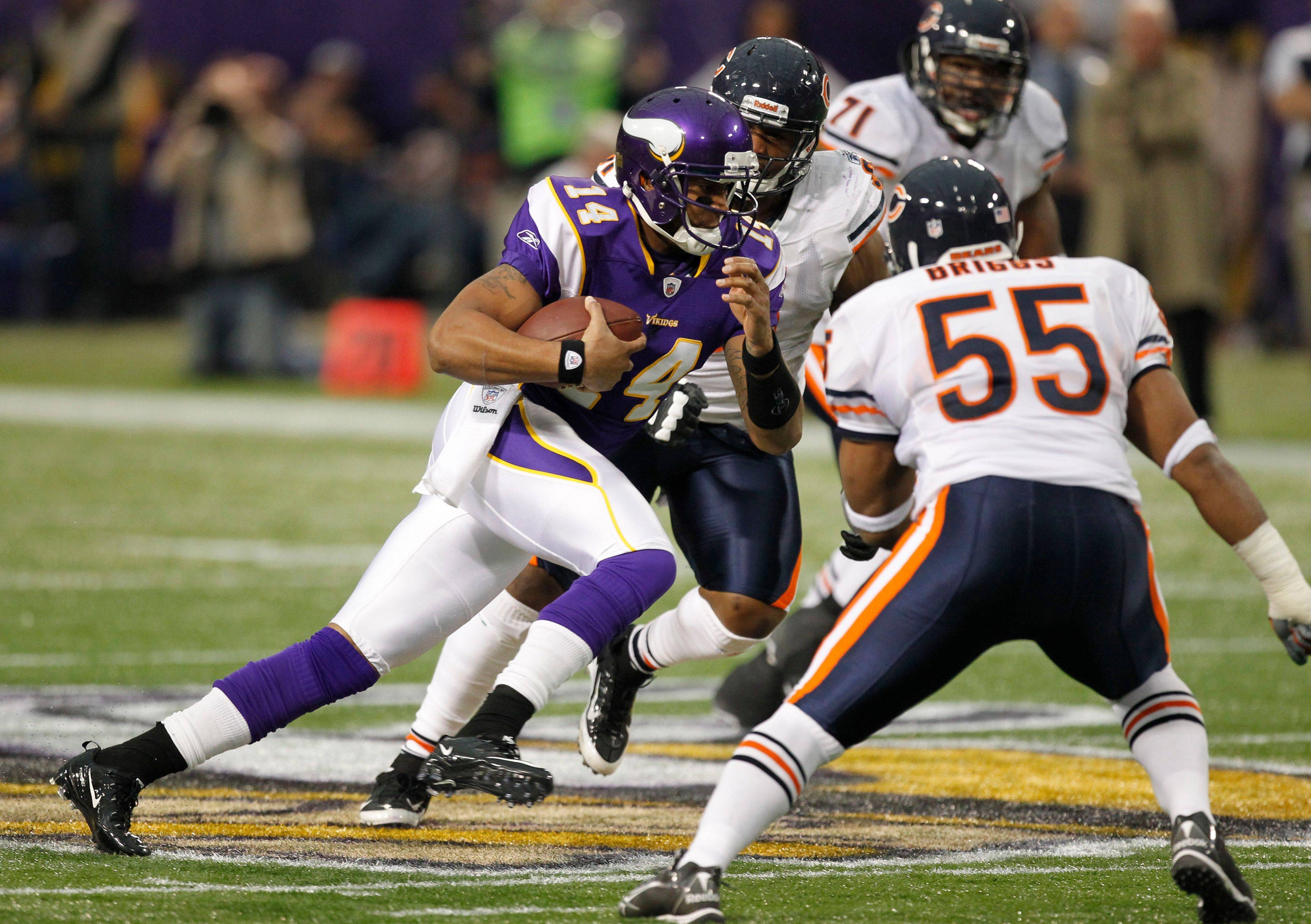 Minnesota Vikings quarterback Joe Webb rushes against the Chicago Bears defense during the first half.