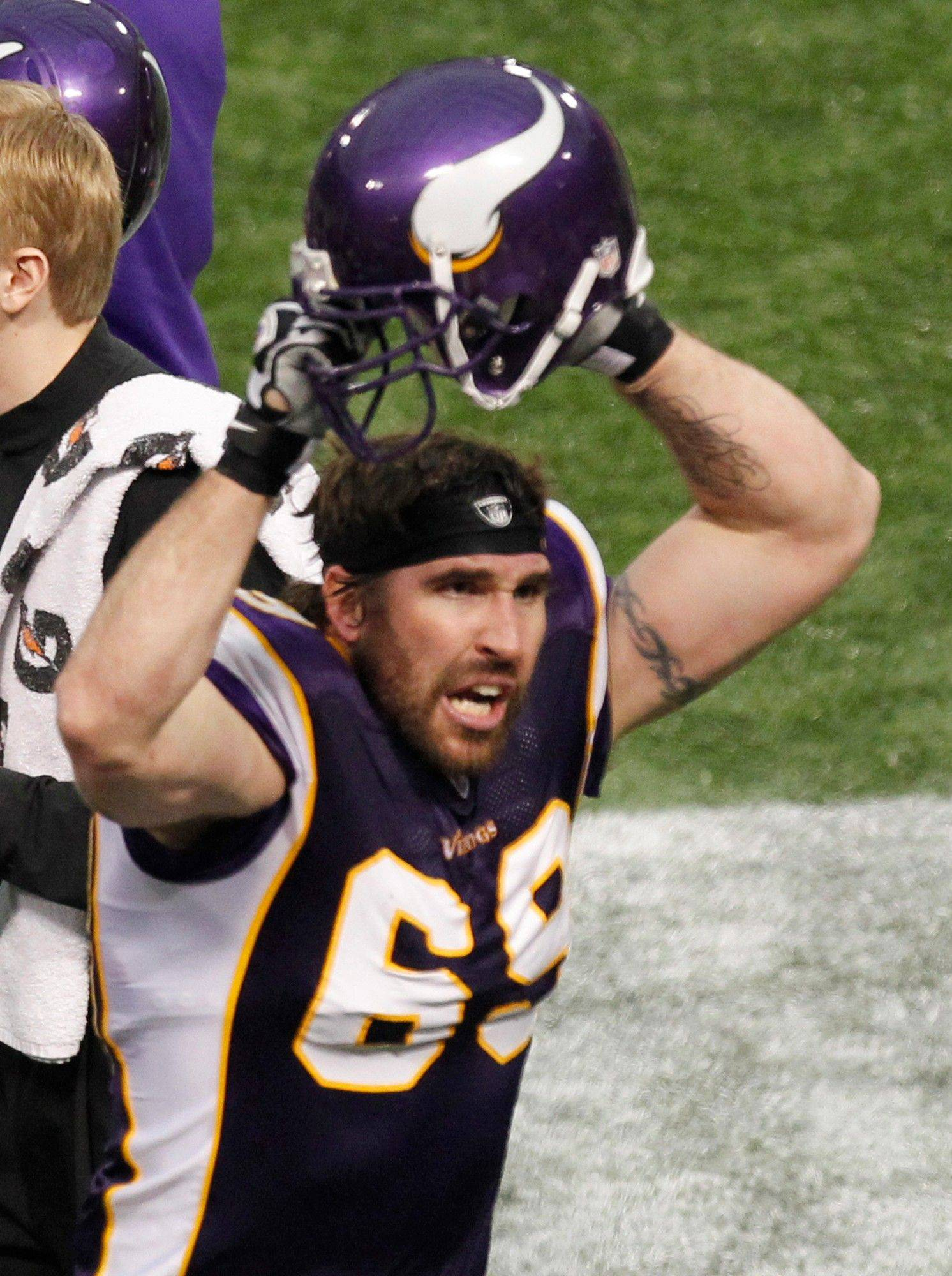 Minnesota Vikings defensive end Jared Allen celebrates on the sideline after sacking Chicago Bears quarterback Josh McCown in the second half. Allen broke the team's single-season sack record of 21.5 on the play, set by Chris Doleman in 1989.