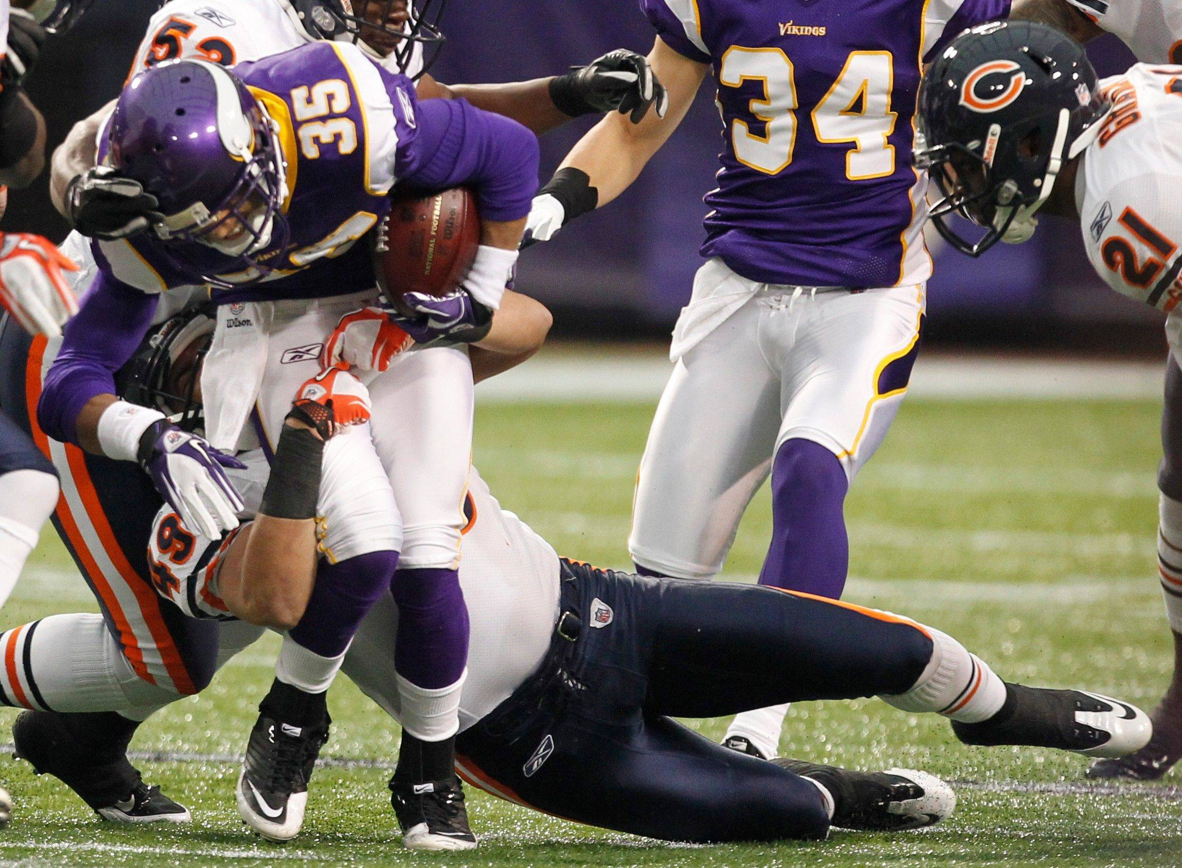 Minnesota Vikings cornerback Marcus Sherels gets tackled by Chicago Bears strong safety Winston Venable on a kickoff return in the first half.