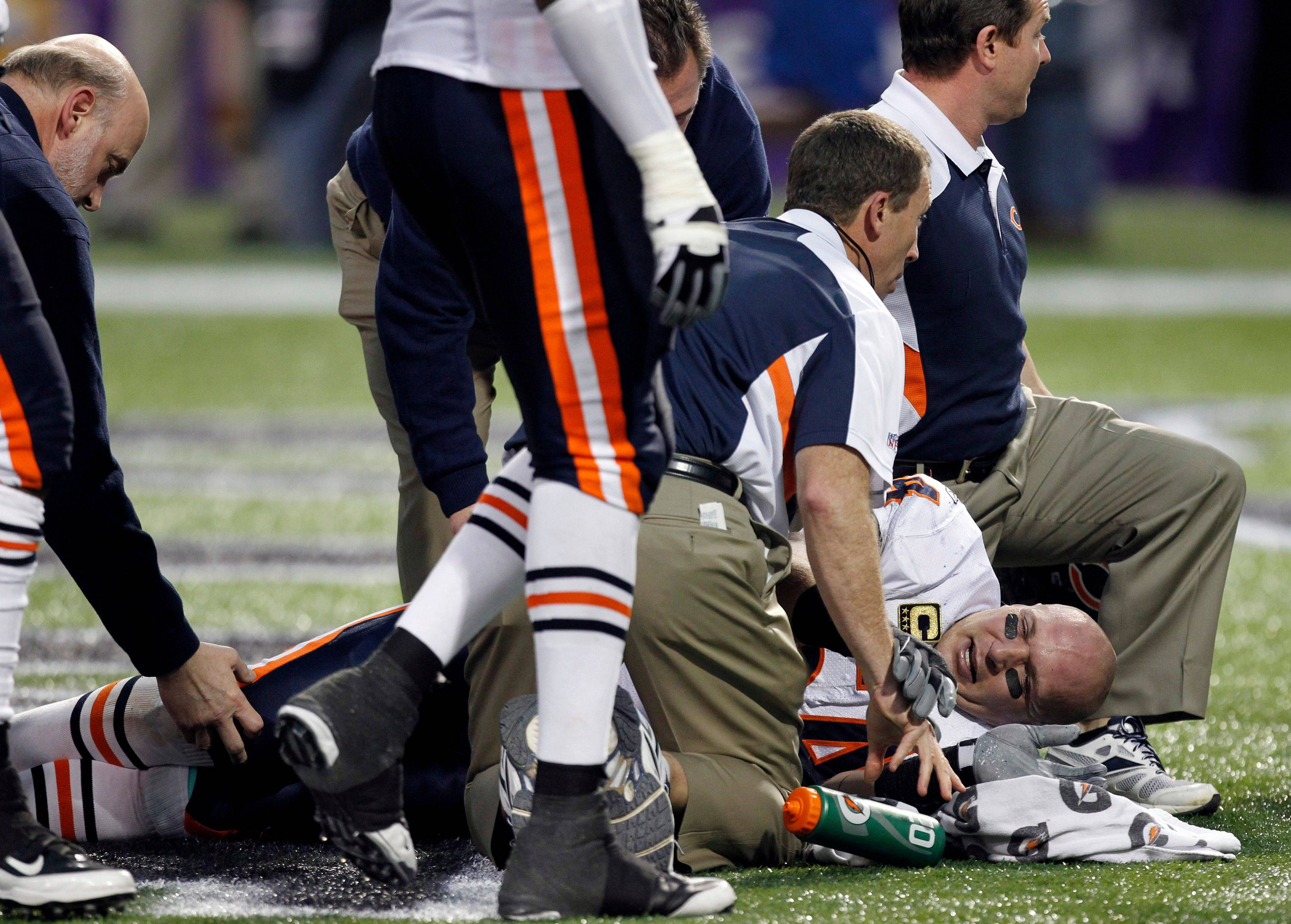 Chicago Bears middle linebacker Brian Urlacher is checked after getting injured during the second half. Urlacher was able to walk off the field without assistance.
