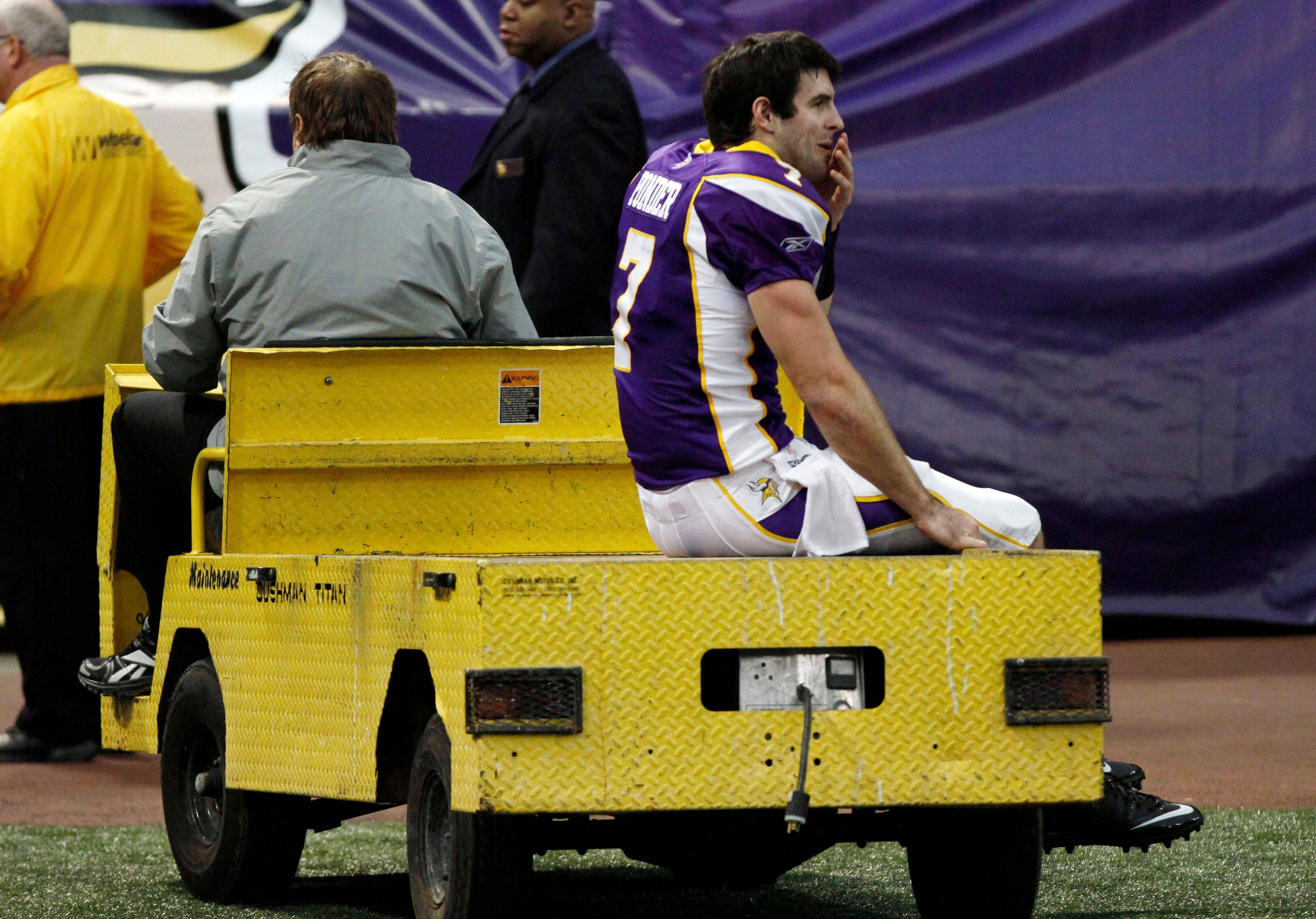 Minnesota Vikings quarterback Christian Ponder is carted off the field after getting injured during the first half. The rookie was crunched by Bears defensive lineman Israel Idonije just after throwing an incomplete pass.