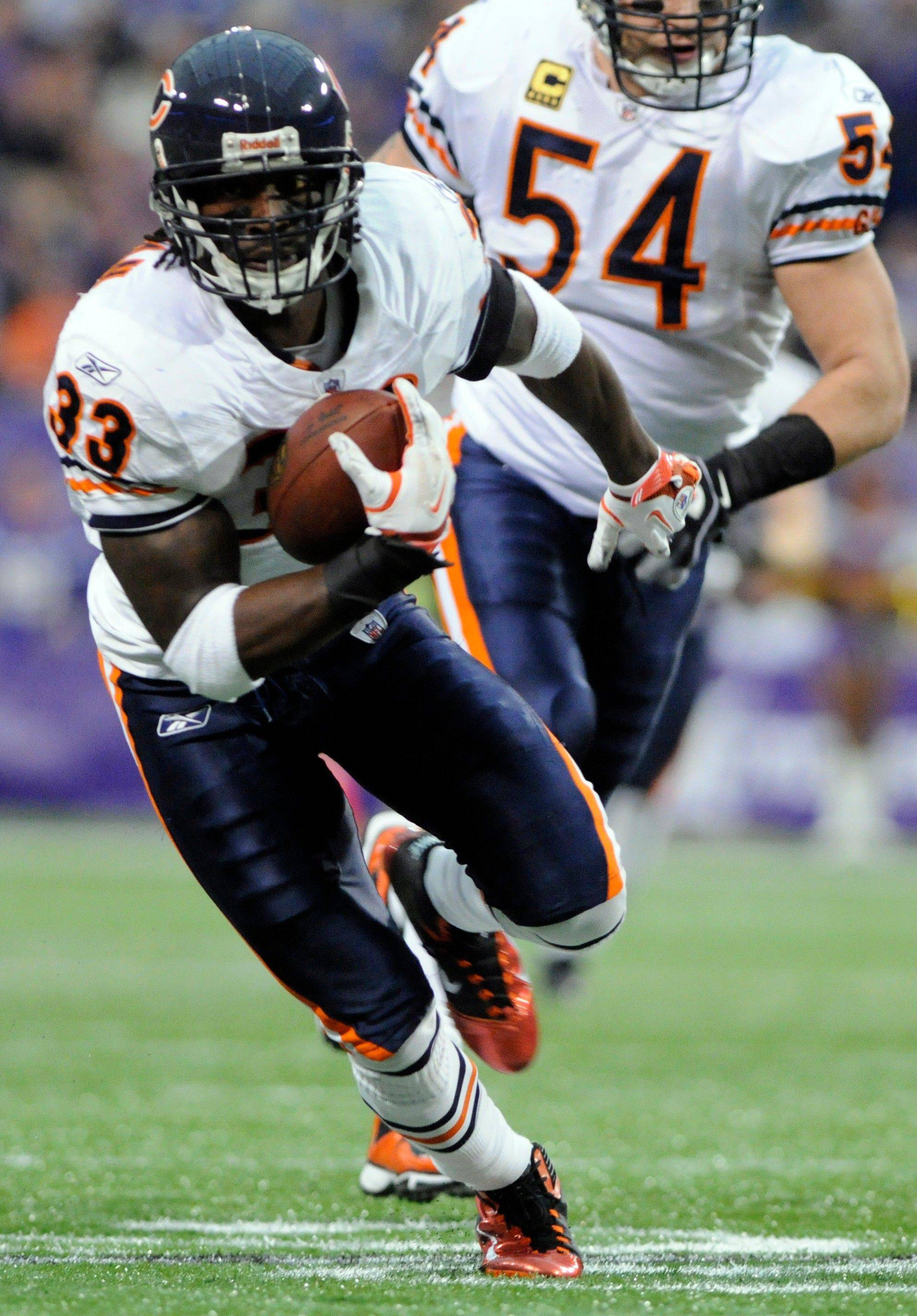 Chicago Bears cornerback Charles Tillman makes a 22-yard interception return in the first half.