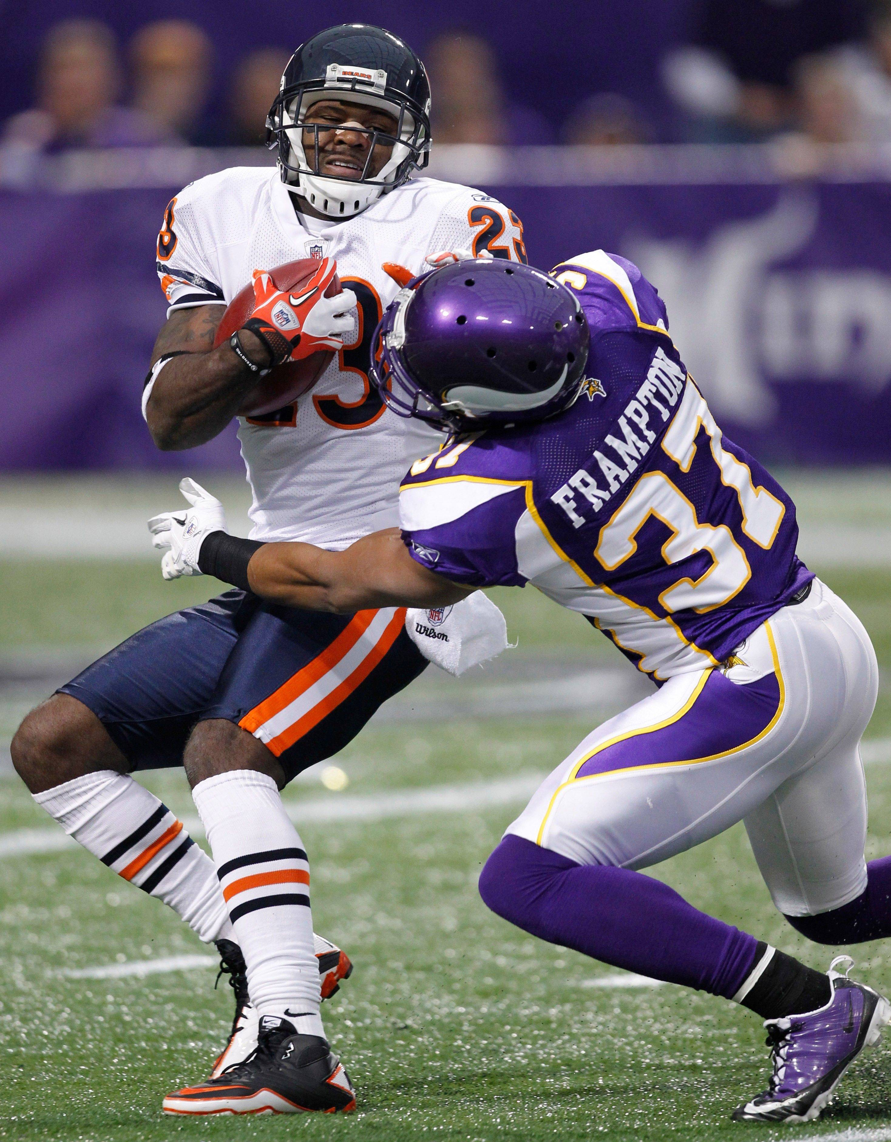 Chicago Bears wide receiver Devin Hester is tackled by Minnesota Vikings defensive back Eric Frampton on a kickoff return in the first half.