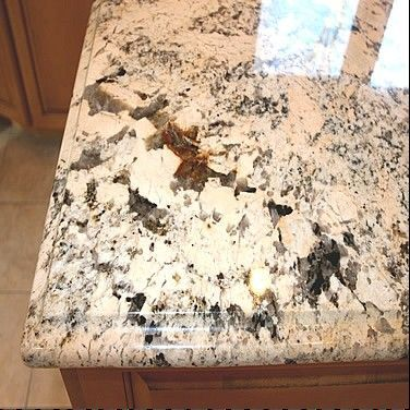 Granite countertops are chosen by the slab in the warehouse based on the color of their cabinets.
