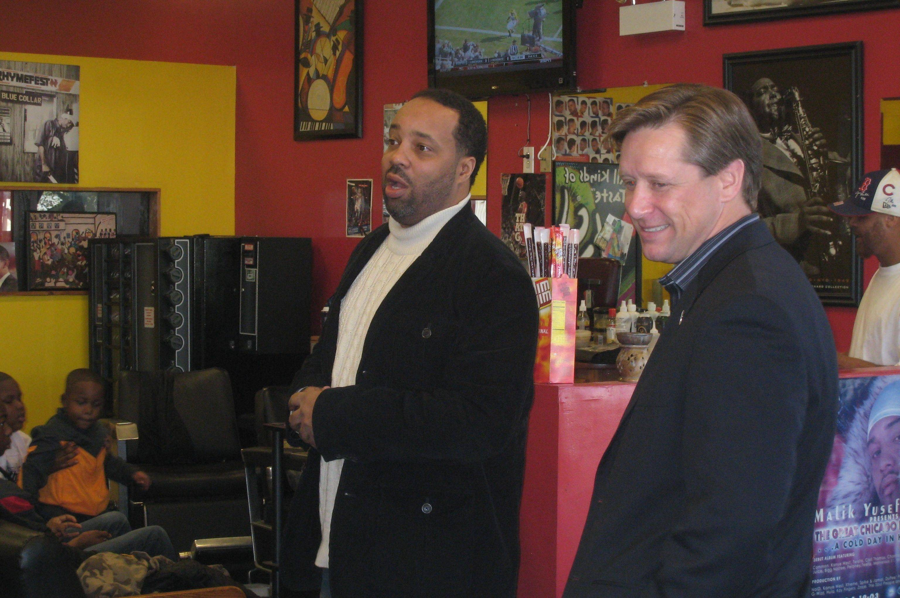 State Sen. Dan Duffy, right, who visited South Side barbershops with the Young Government group, says Republicans need to engage the black electorate.