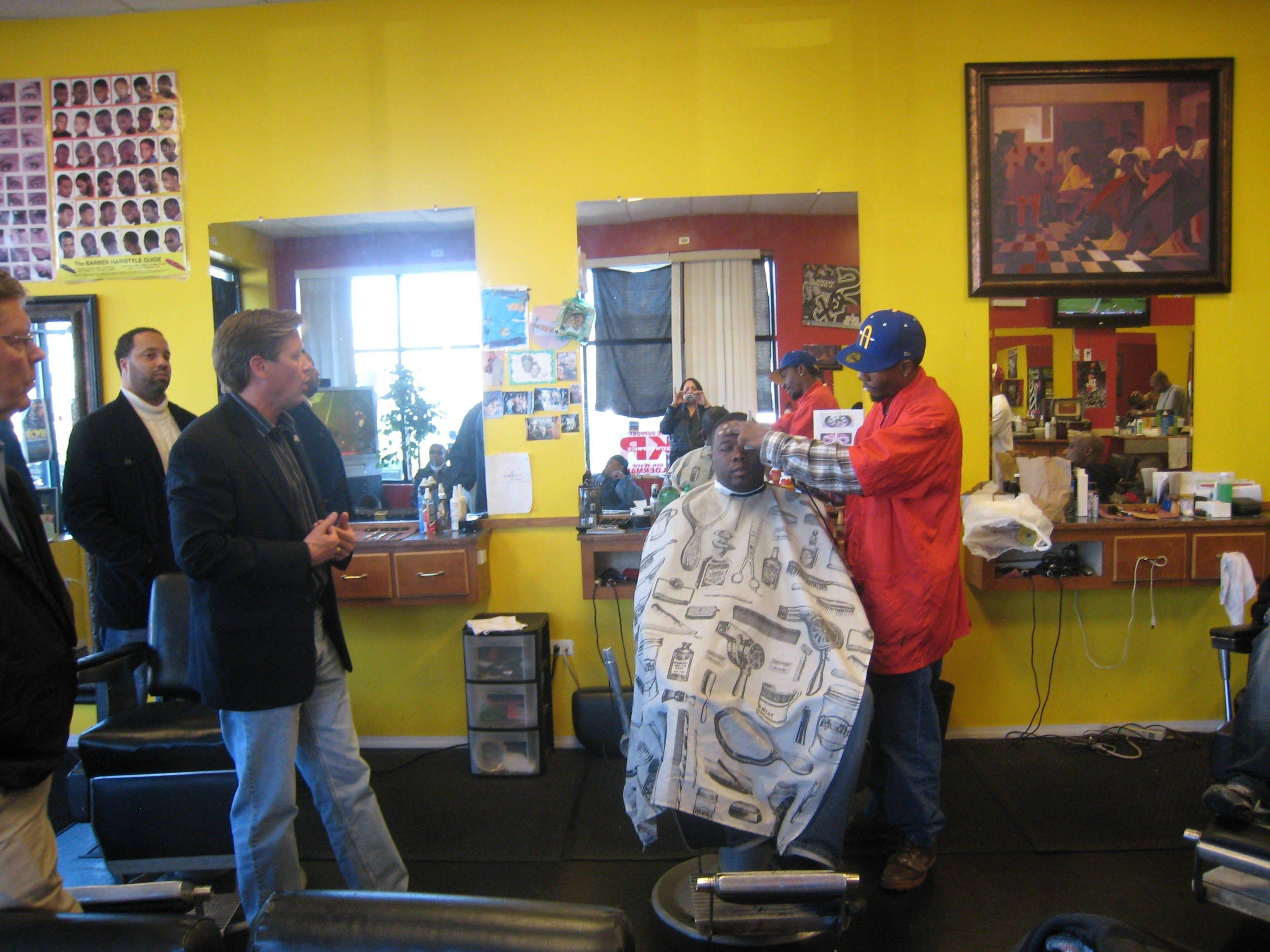 State Sen. Dan Duffy, front left, who grew up on the South side of Chicago but now represents the Barrington area, recently attended a Young Government barbershop tour in Chicago, which aims to link politicians and black voters. Jeffery Coleman, one of the group's organizers, calls barbershops the center of many black neighborhoods, where the real conversation starts.