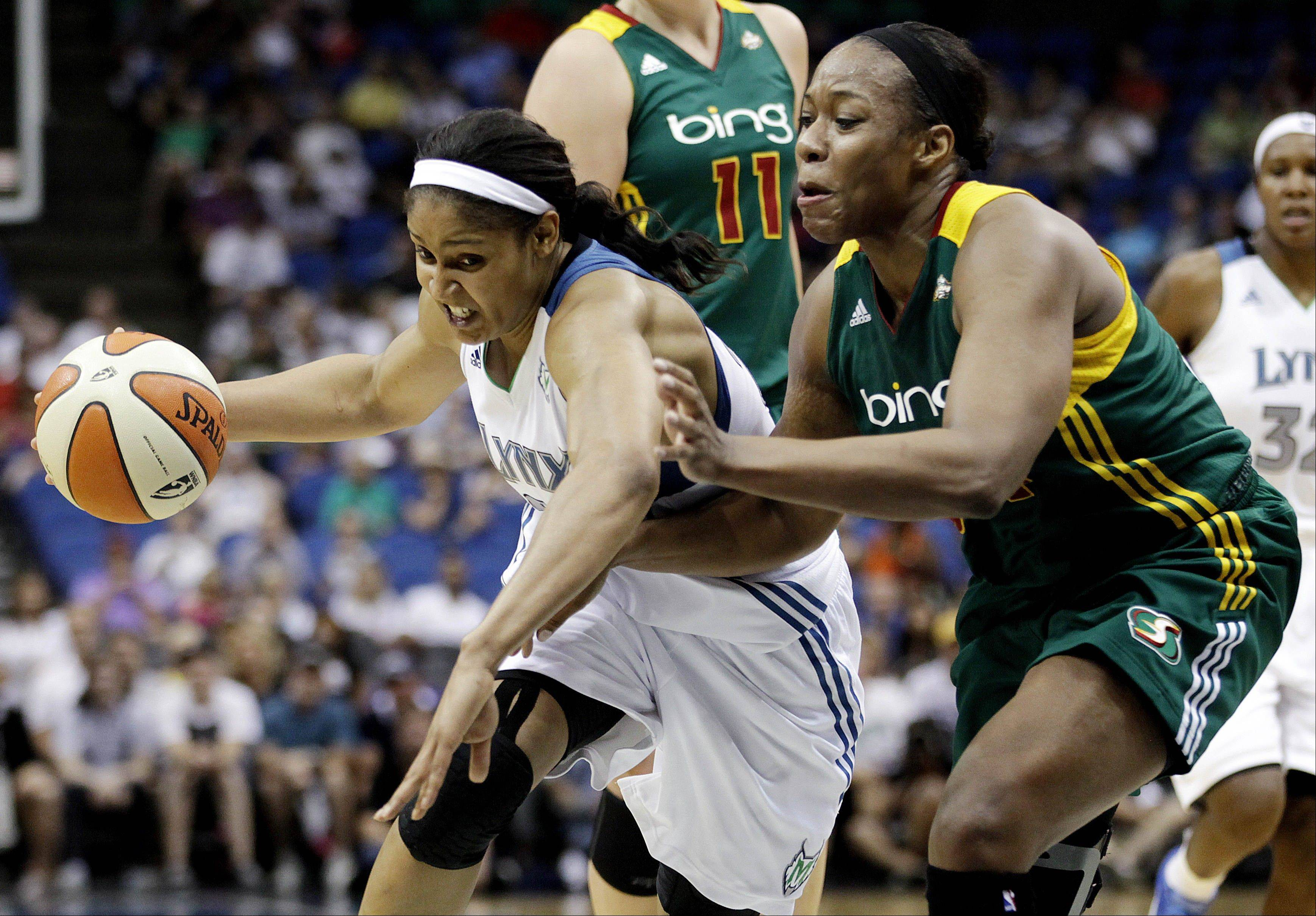 Seattle Storm forward Le'Coe Willingham, right, tries to slow down Minnesota's Maya Moore in a game last July. Willingham was acquired by the Sky on Monday.