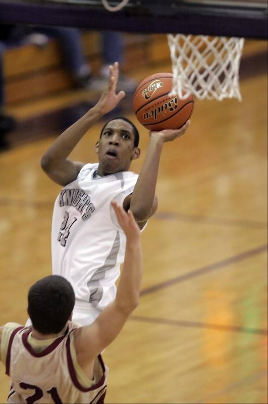 kanelands thomas williams 24 goes to the hoop over morriss jason matteson 21 - Plano Christmas Classic
