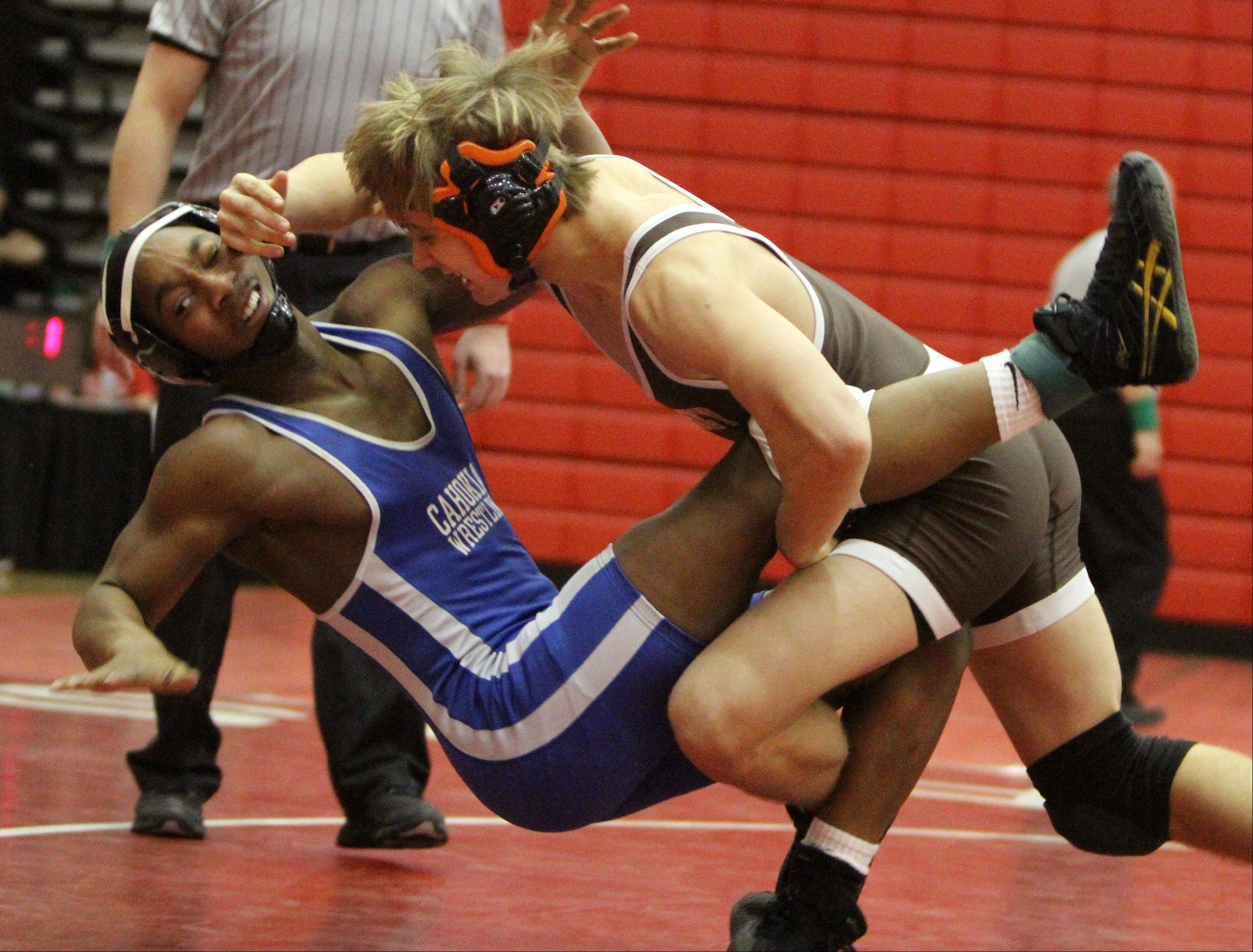 Hersey's Hunter Rollins takes down Cahokia's David Frazier in a 160-pound match at the 57th Annual Berman Holiday Classic wrestling meet in Palatine Wednesday.