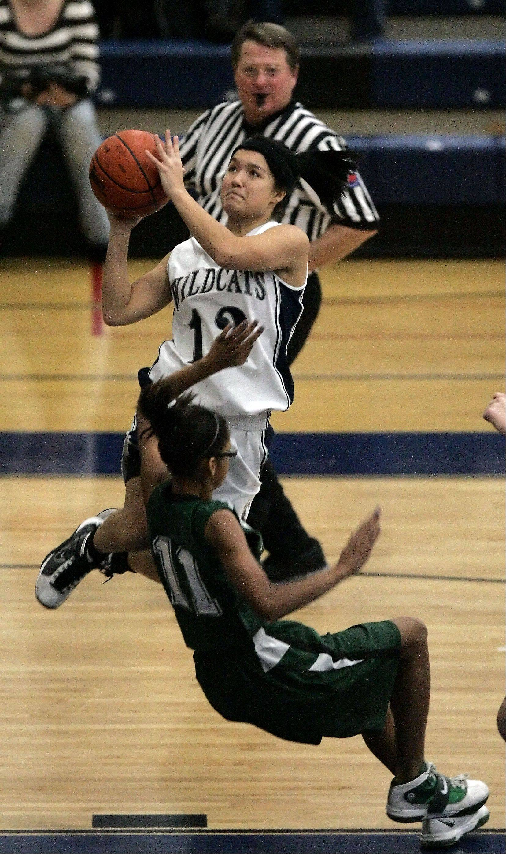 West Chicago's Liz Reyes, 12, goes to the hoop past Plainfield Central's Jessica Kudia, 11, at the 2011 Wolves Winter Classic Basketball Tournament in Oswego Wednesday.
