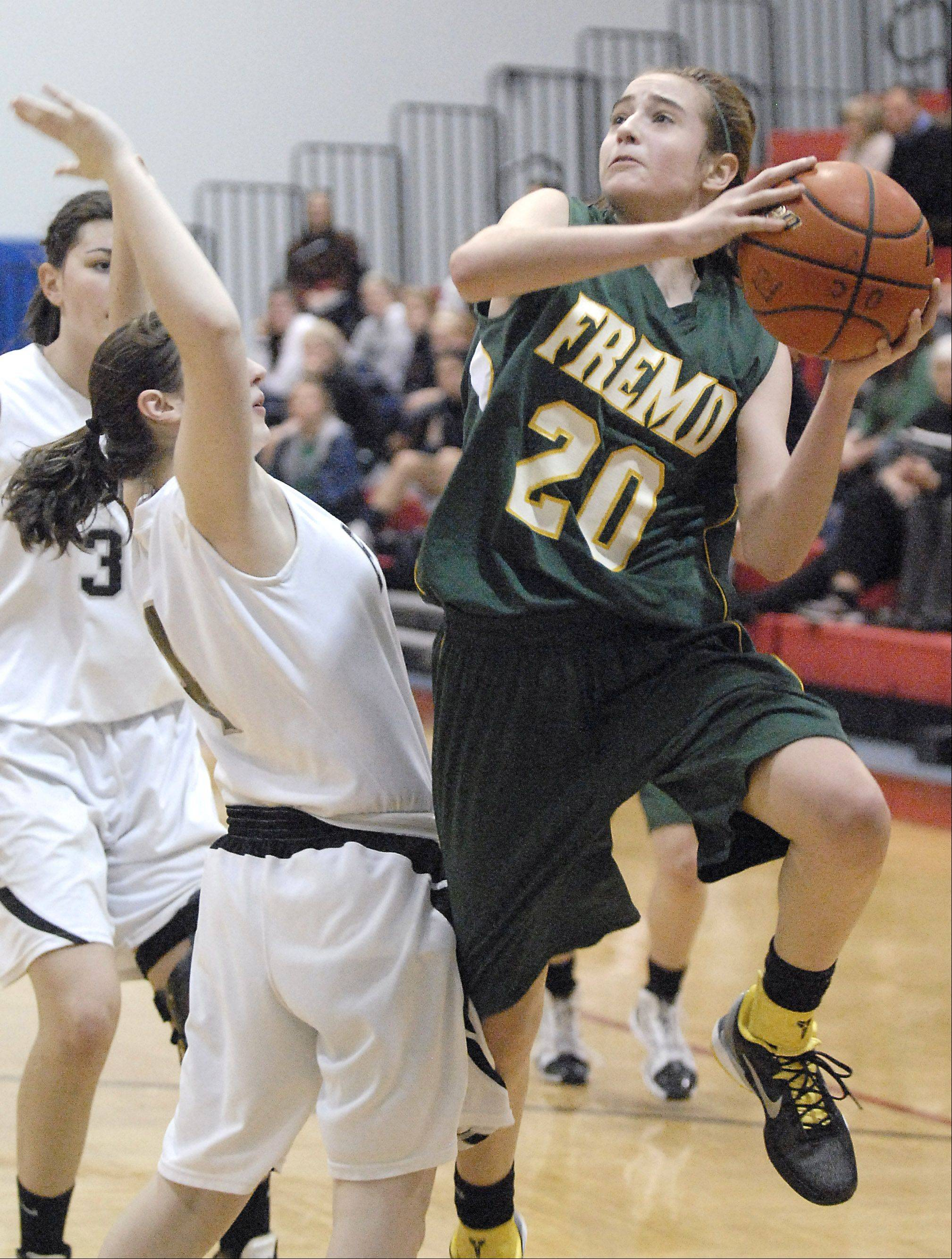 Fremd's Haley Gorecki shoots over Fenwick's Paige Corvino during Thursday's basketball game at Dundee-Crown High School in Carpentersville.