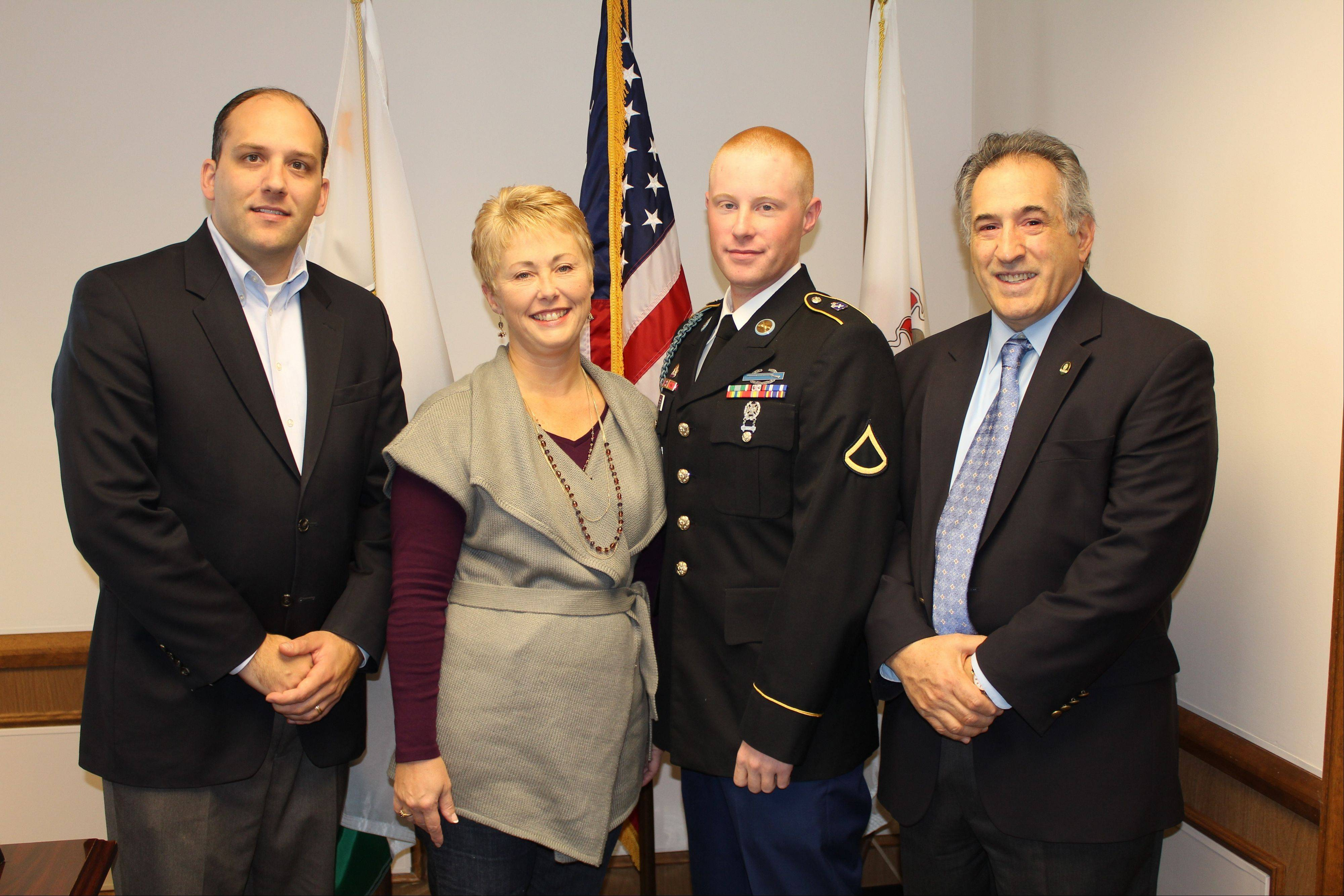 Pictured, from left, acting City Manager Jason Slowinski, Paula Steffan, Private 1st Class Jacob Steffan and Mayor Martin J. Moylan. Private Steffan, who has left for Afghanistan, is expected to return to the United States by March, 2012.