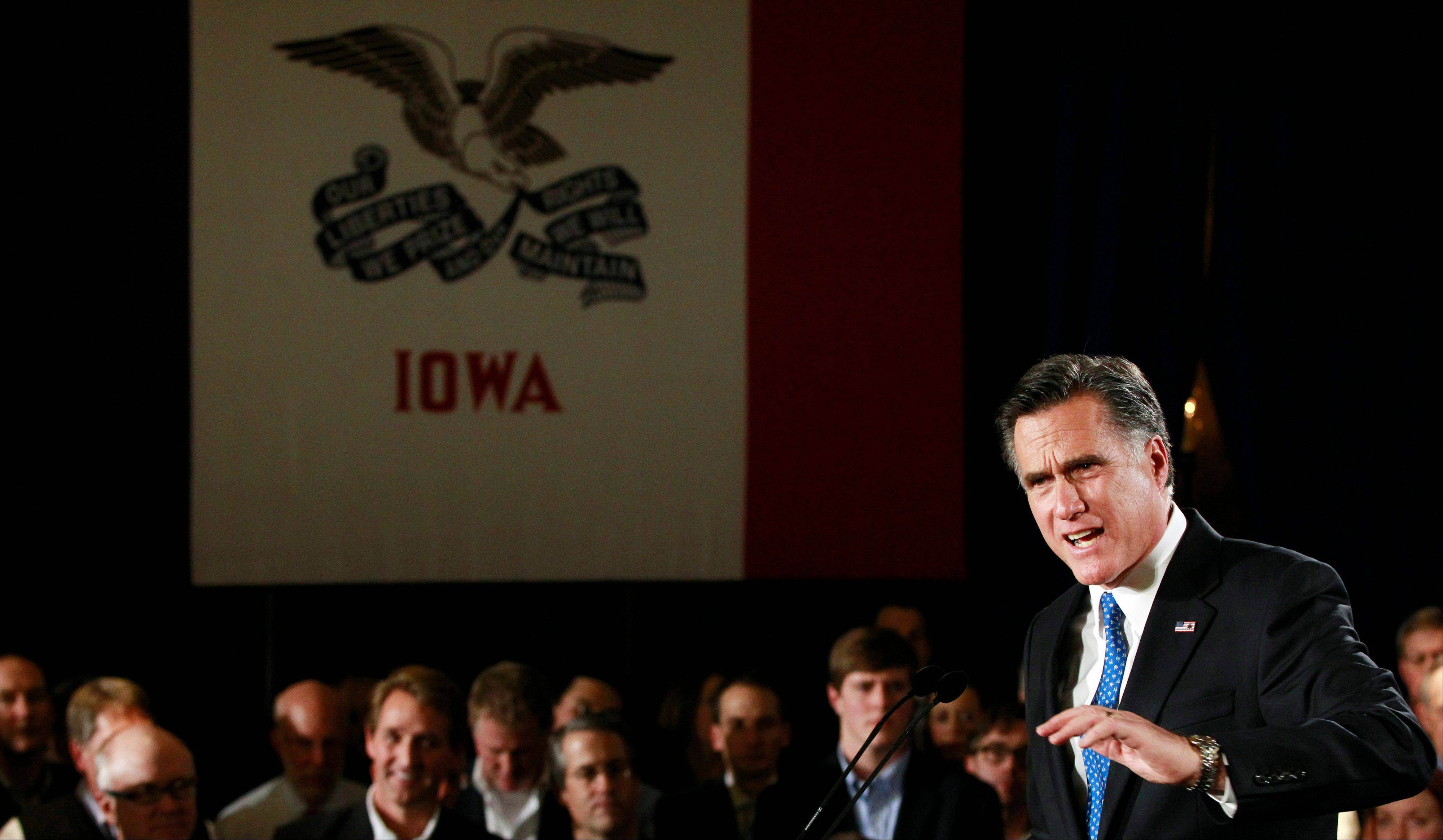 Republican presidential candidate, former Massachusetts Gov. Mitt Romney, speaks at his caucus night rally in Des Moines, Iowa, Tuesday, Jan. 3, 2012.