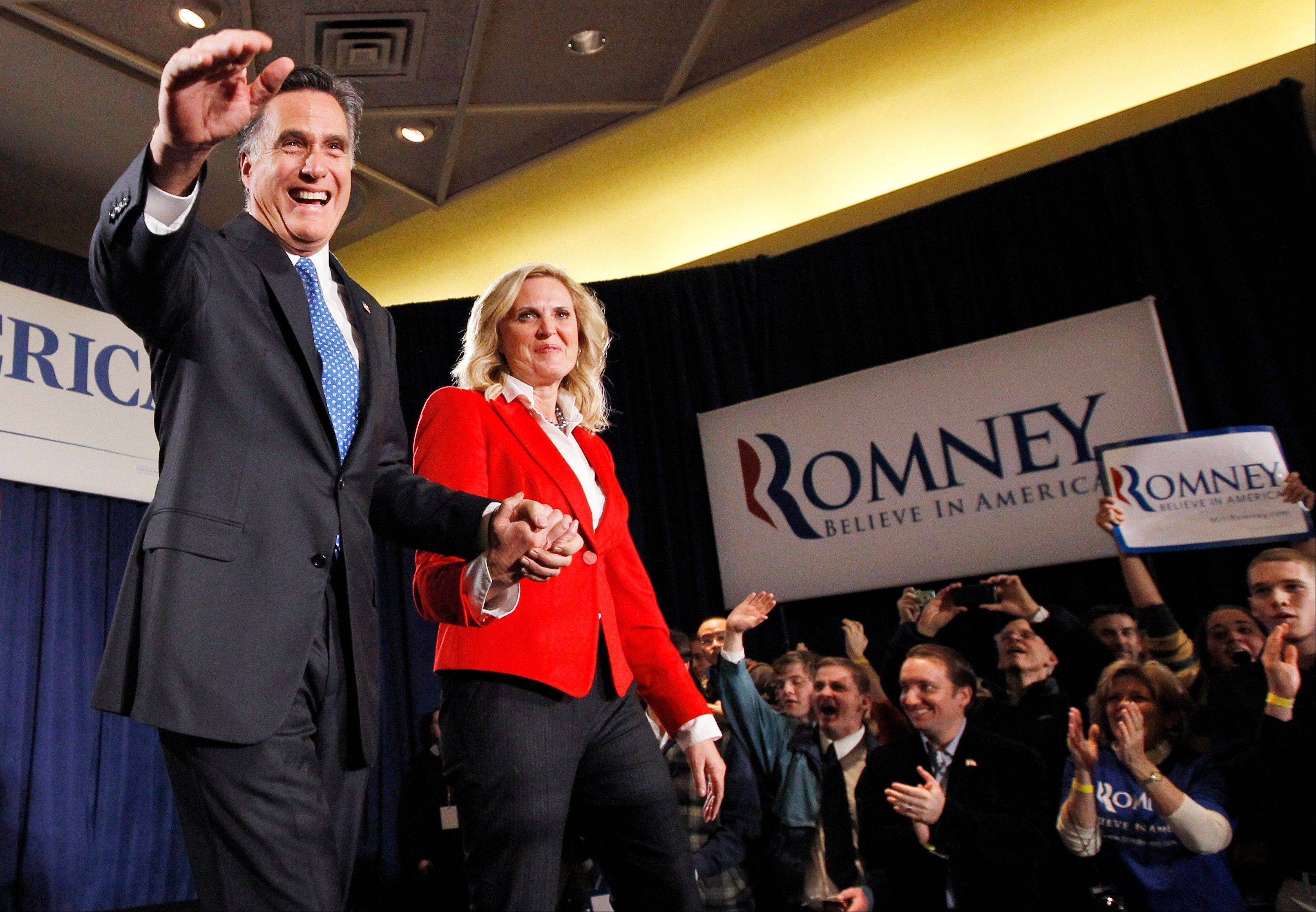 Republican presidential candidate, former Massachusetts Gov. Mitt Romney, takes the stage with his wife Ann at his caucus night rally in Des Moines, Iowa, Tuesday, Jan. 3, 2012.