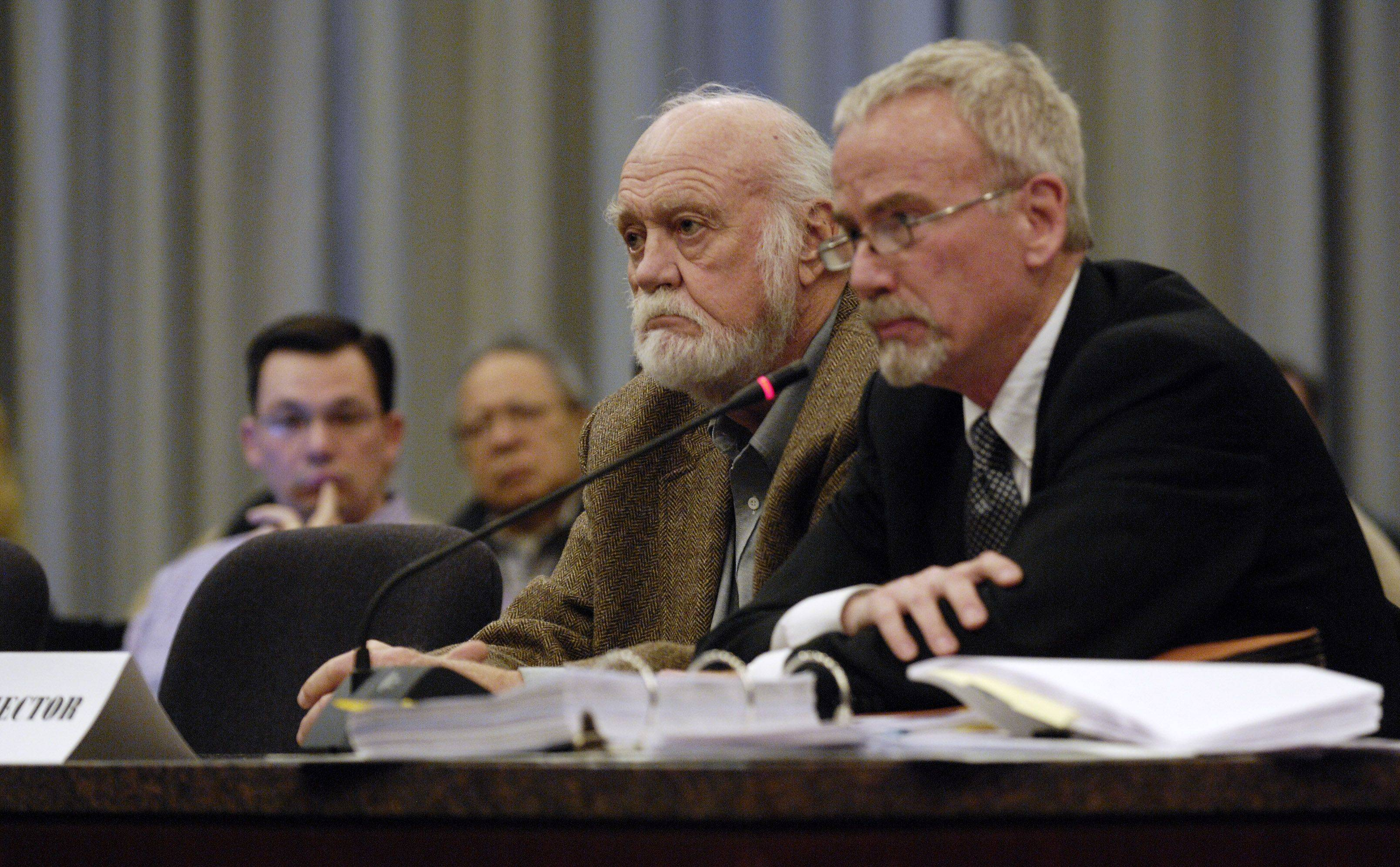 Objector William Dawe and his attorney Kevin McQuillan attend a Tuesday hearing of Naperville's Electoral Board on an objection to a referendum on proposed smart meters.