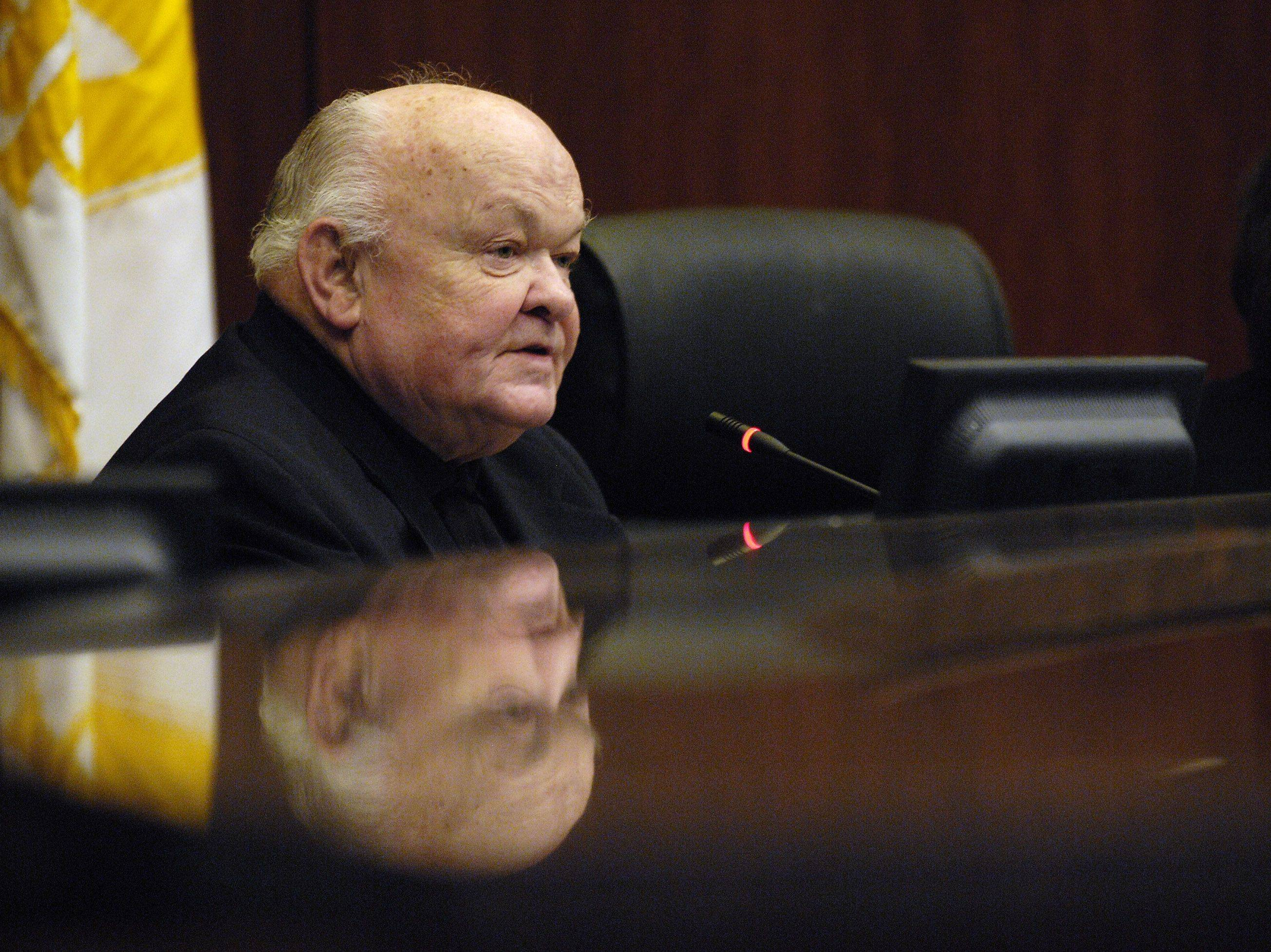 Naperville Mayor George Pradel on Tuesday presides over a hearing of Naperville's Electoral Board for the proposed smart meters, to monitor electrical use in the city.