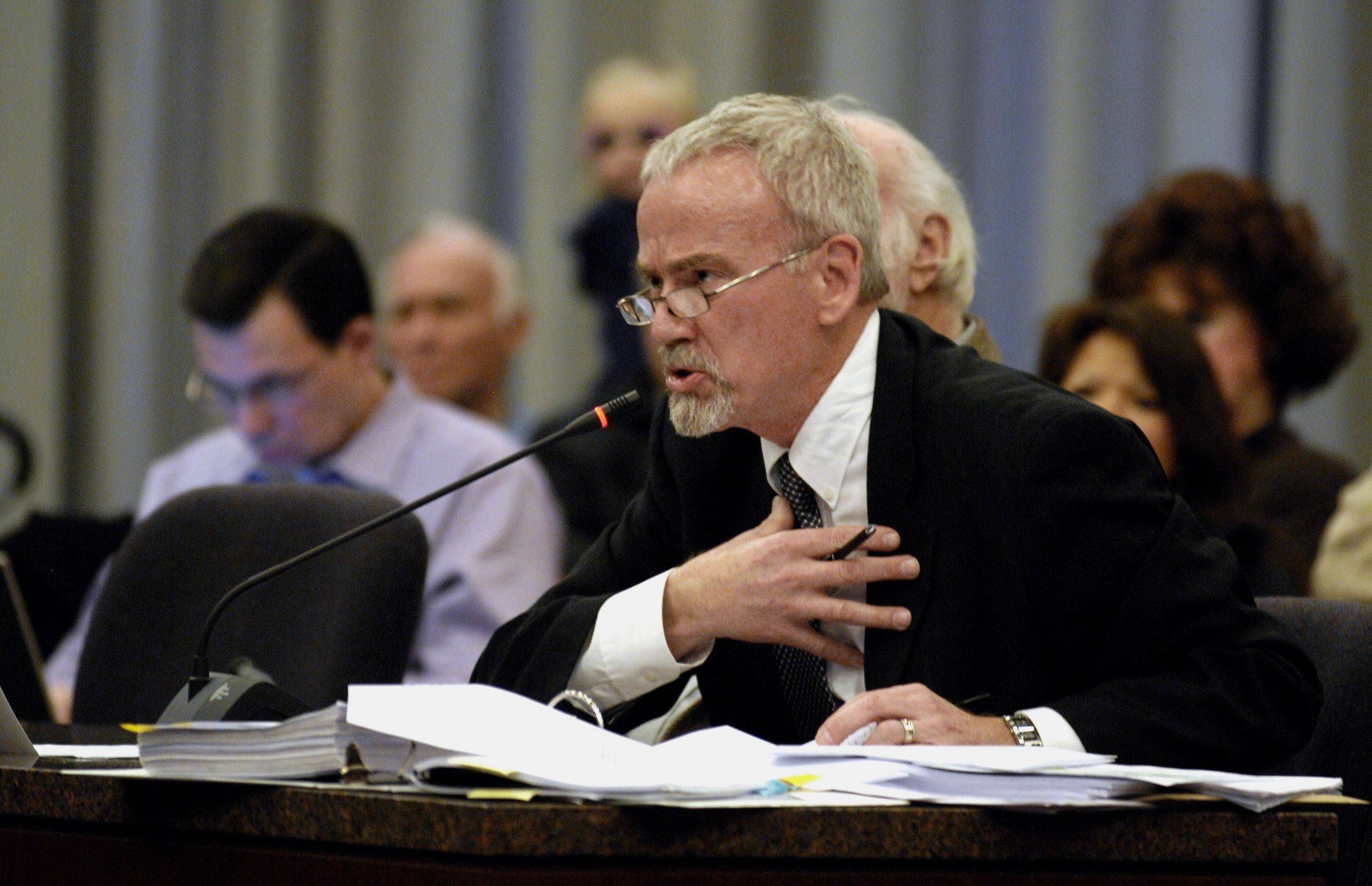 Objector William Dawe's attorney, Kevin McQuillan, pleads his case Tuesday during a hearing of Naperville's Electoral Board regarding the proposed smart meters, to monitor electrical use in the city.