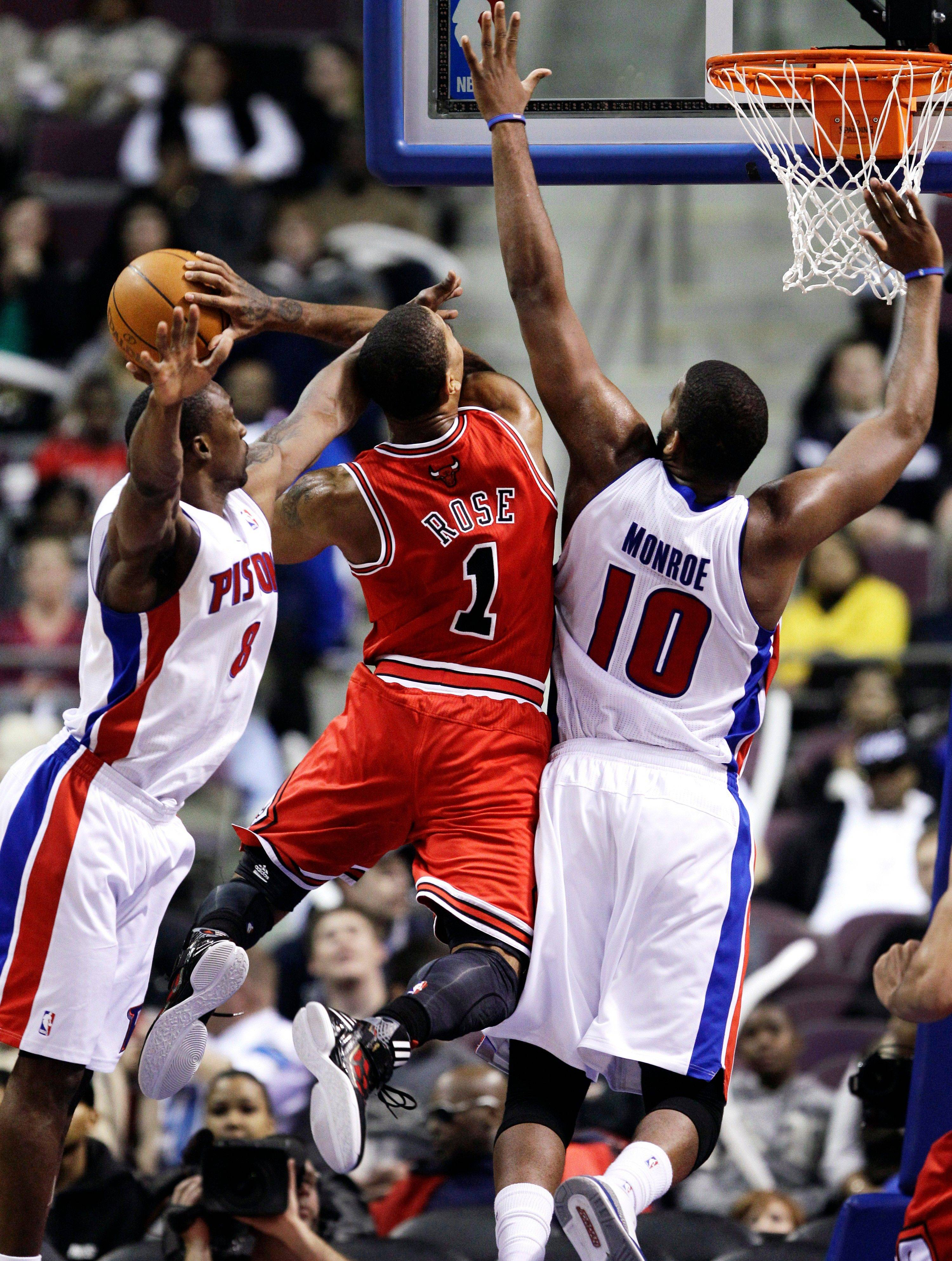 Bulls guard Derrick Rose drives on the Pistons' Ben Gordon (8) and center Greg Monroe (10) in the fourth quarter Wednesday night. Chicago won 99-83.