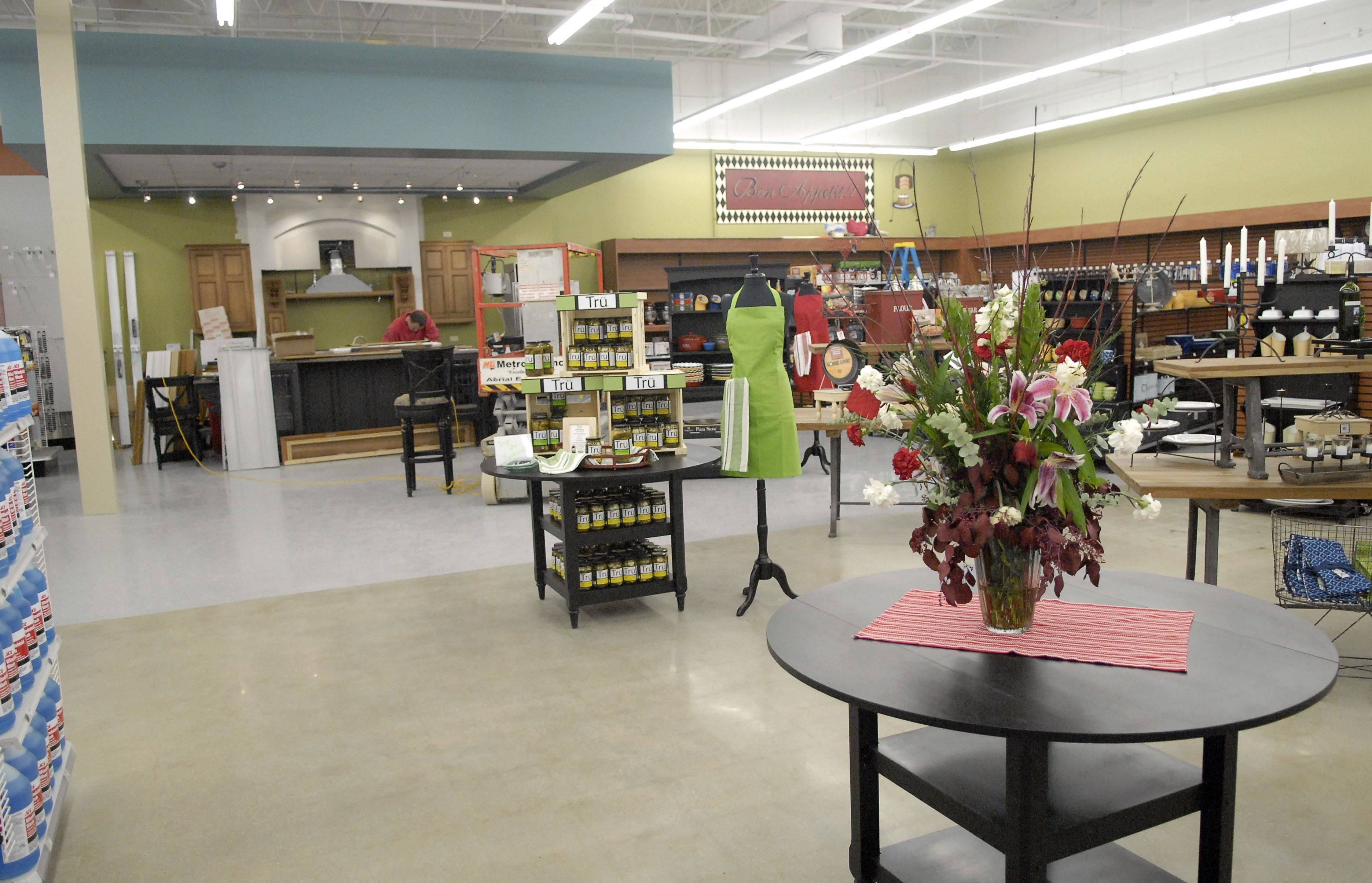 The Geneva Ace Hardware has reopened with new owners, George and Lynn Havlicek. The layout is different from in the past and there is a design area handled by Lynn, an interior designer. A demonstration kitchen is also being installed.