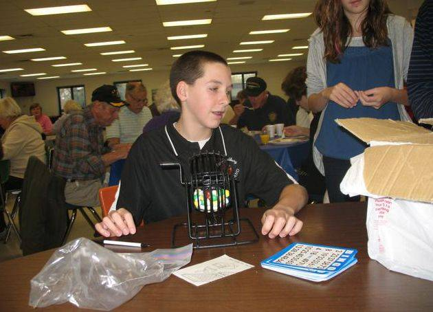 Students play bingo during the Carl Sandburg Middle School senior citizen breakfast. The school's student council sponsors this event.