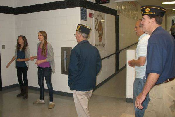 Carl Sandburg Middle School students give veterans a tour of the Mundelein school during the breakfast.
