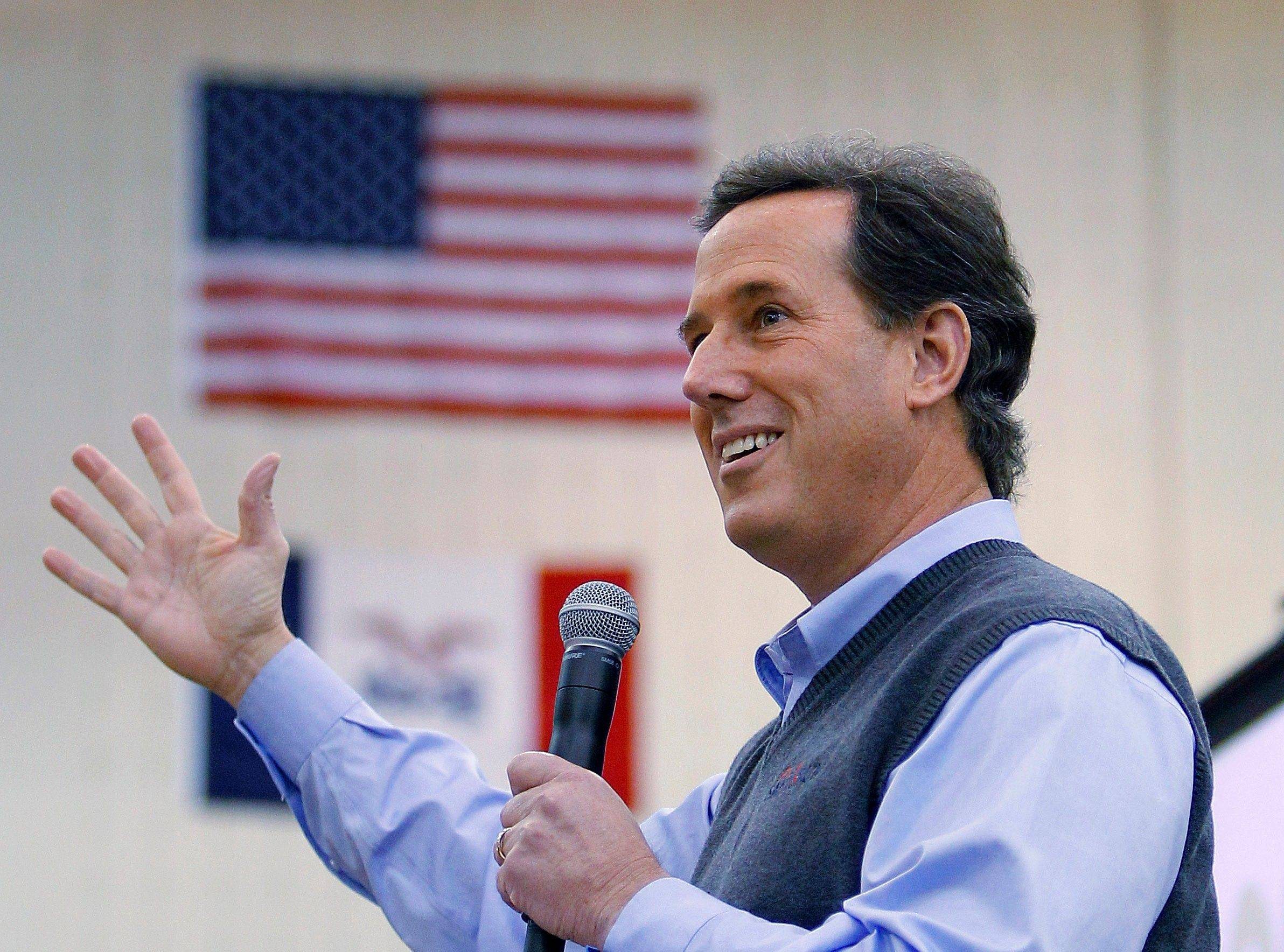 Republican presidential candidate Rick Santorum speaks during a forum in Iowa before that state's GOP caucuses. A fellow Carmel High graduate is helping to run his campaign in Illinois.