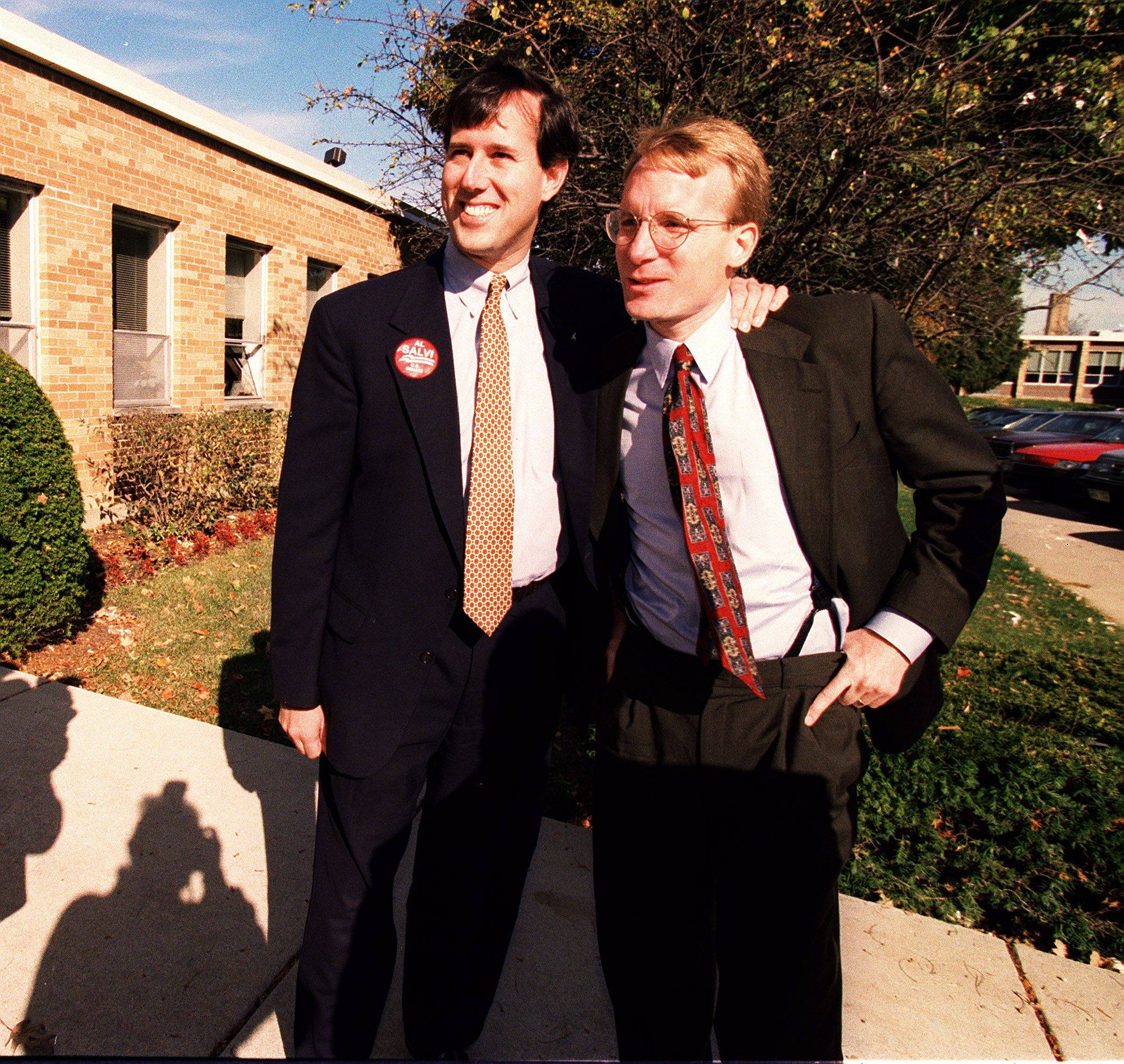 Then-Sen. Rick Santorum, left, with Al Salvi outside Mundelein's Carmel Catholic High School in 1996.