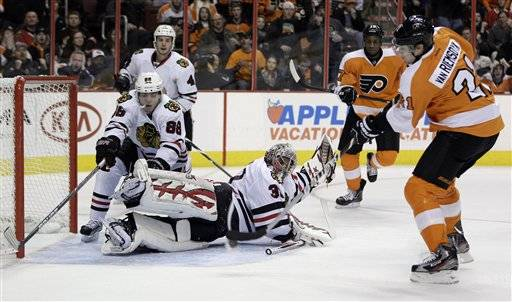 Philadelphia Flyers' James van Riemsdyk (21) shoots a goal past Chicago Blackhawks' Ray Emery (30) and Patrick Kane (88) in the second period of an NHL hockey game on Thursday, Jan. 5, 2012, in Philadelphia.