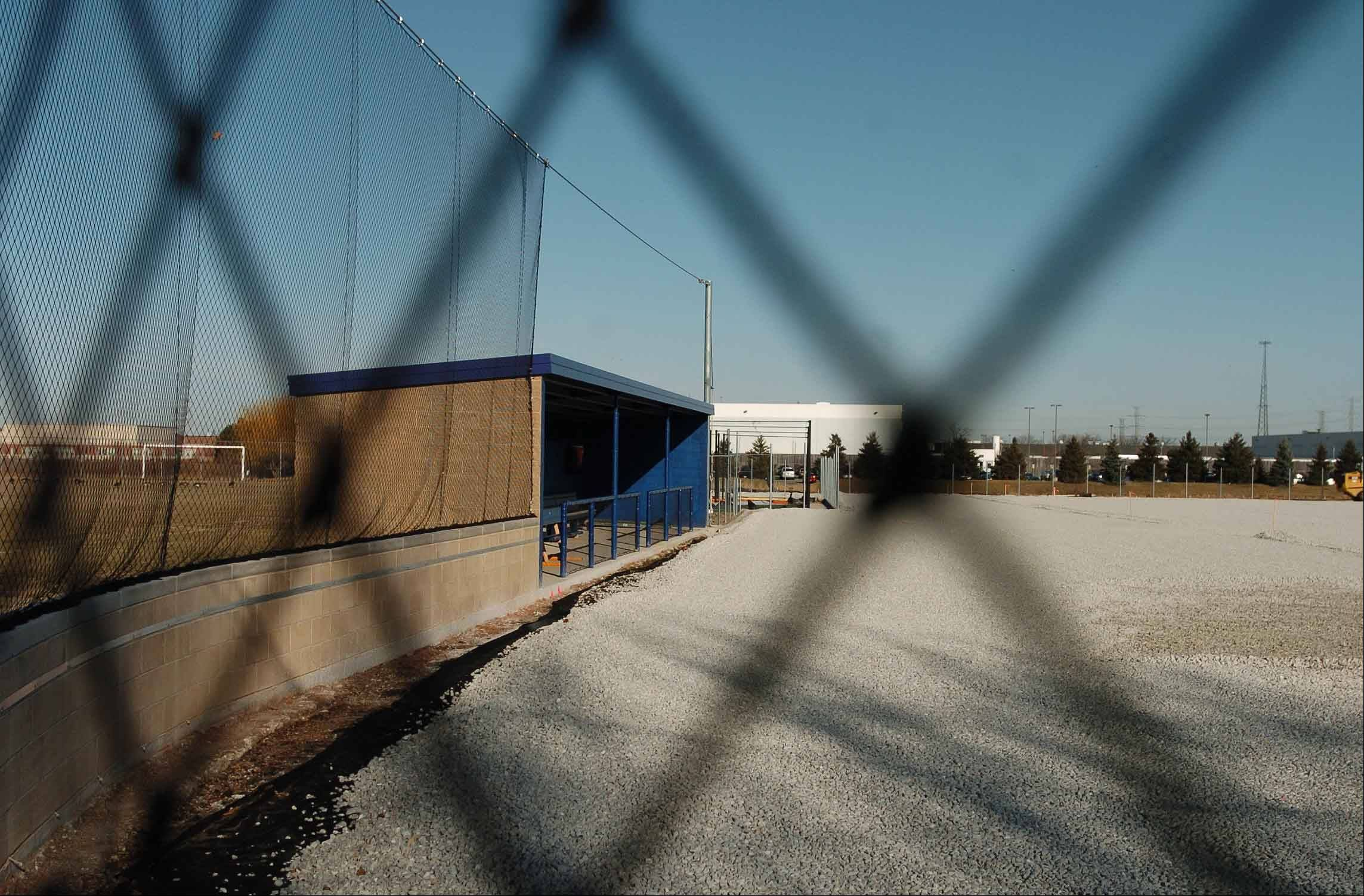 Neighbors balk at Wheaton College's baseball field improvements