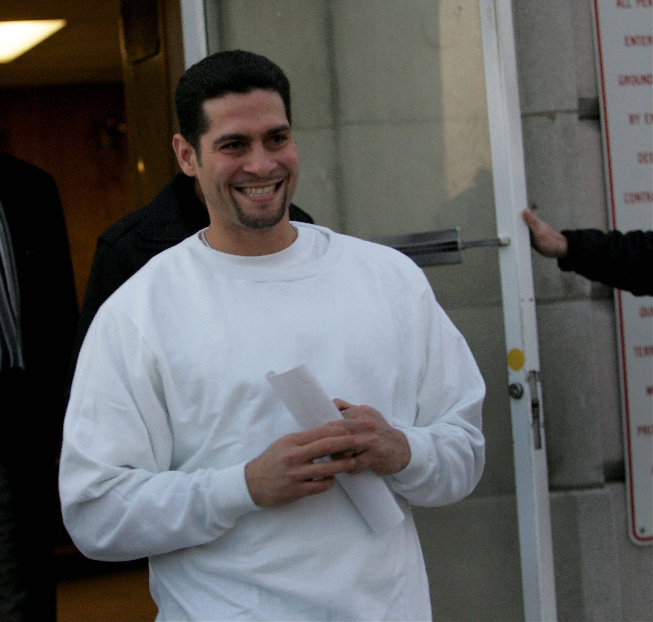 Juan Rivera is all smiles as he walks out of Stateville Correctional Center in Crest Hill.